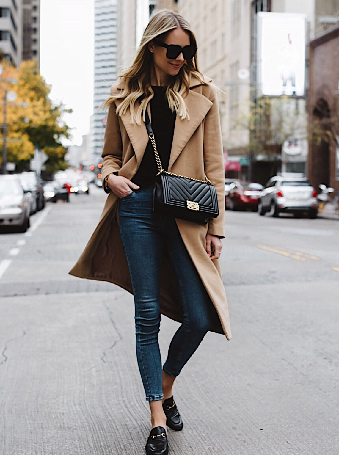 blonde woman wearing long camel coat black sweater topshop denim skinny jeans gucci black mules chanel black boy bag fashion jackson dallas blogger fashion blogger street style