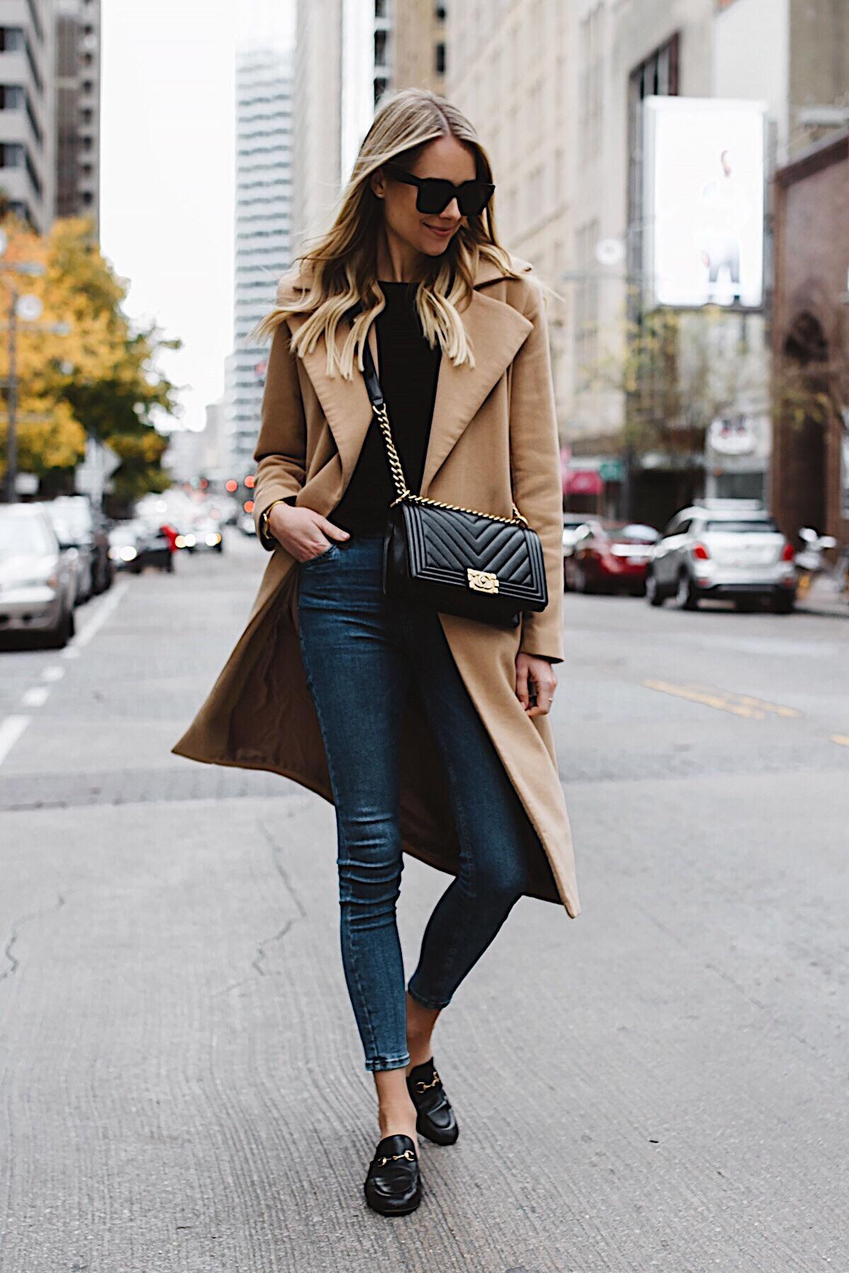 blonde woman wearing long camel coat black sweater topshop denim skinny jeans gucci black mules chanel black boy bag fashion jackson dallas blogger fashion blogger street style