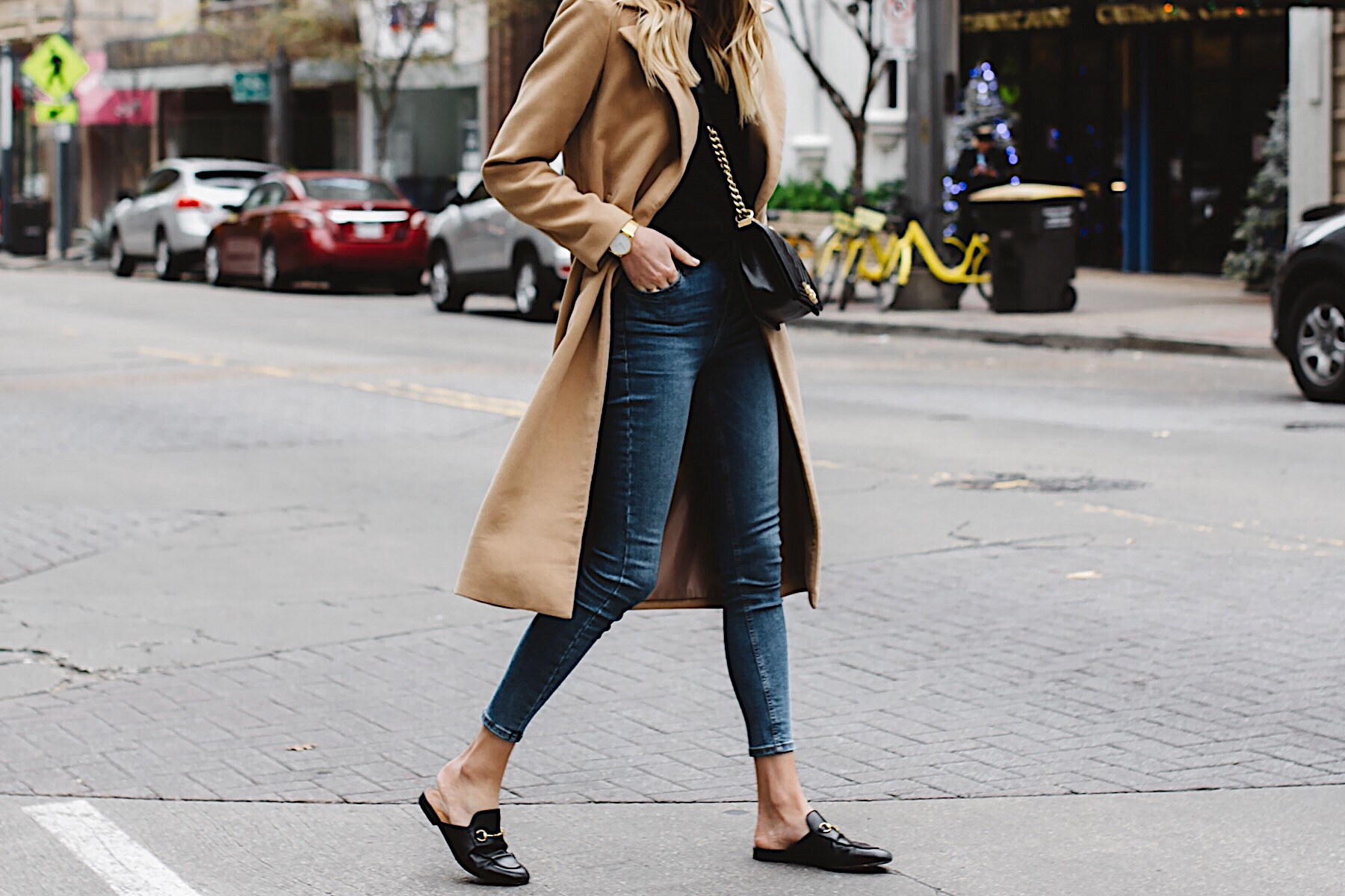 woman wearing long camel coat black sweater topshop denim skinny jeans gucci black mules chanel black boy bag fashion jackson dallas blogger fashion blogger street style