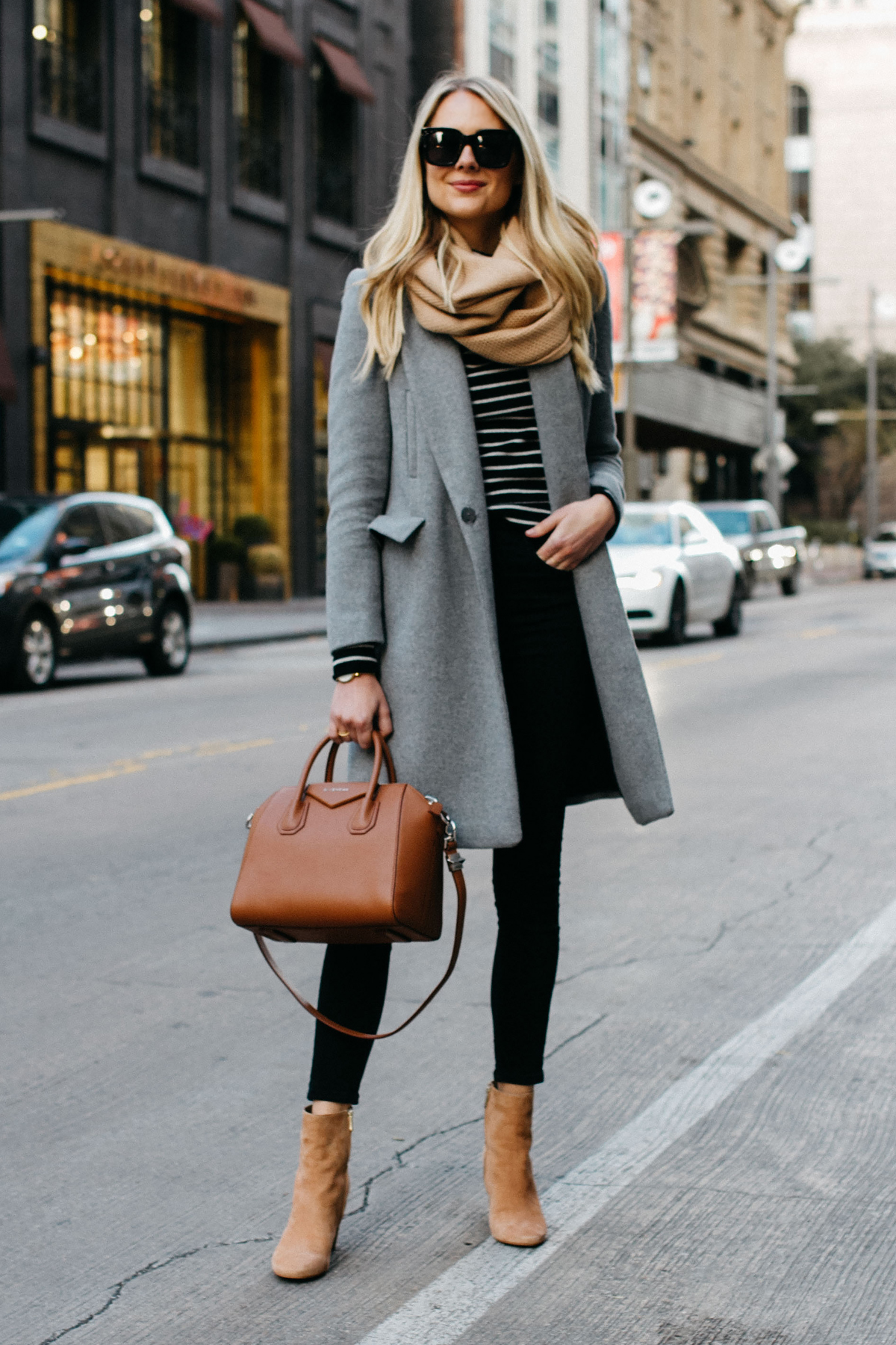 blonde women wearing zara grey wool coat tan scarf black white striped sweater black skinny jeans sam edelman cora tan booties givenchy cognac antigona satchel fashion jackson dallas blogger fashion blogger street style