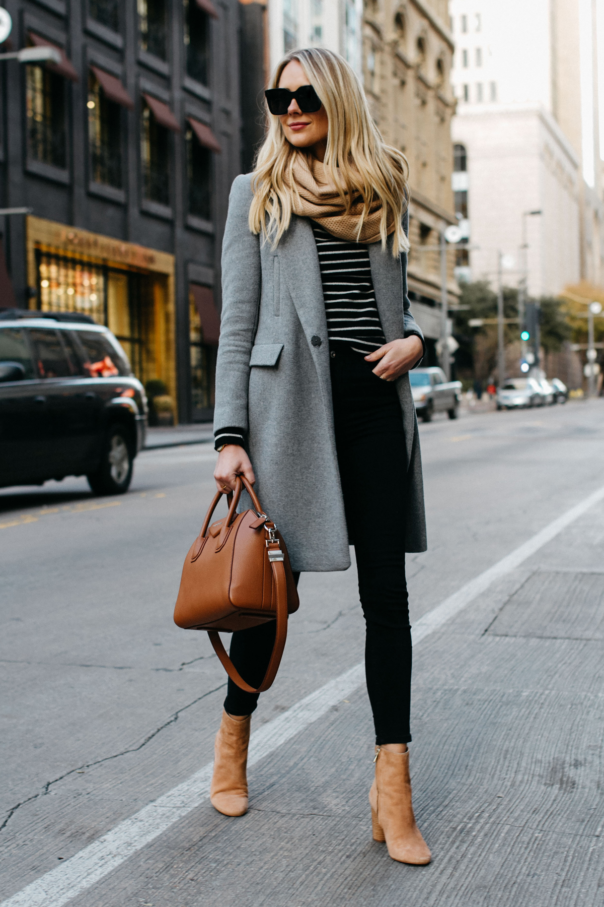 blonde woman wearing zara grey wool coat tan scarf black white striped sweater black skinny jeans sam edelman cora tan booties givenchy cognac antigona satchel fashion jackson dallas blogger fashion blogger street style