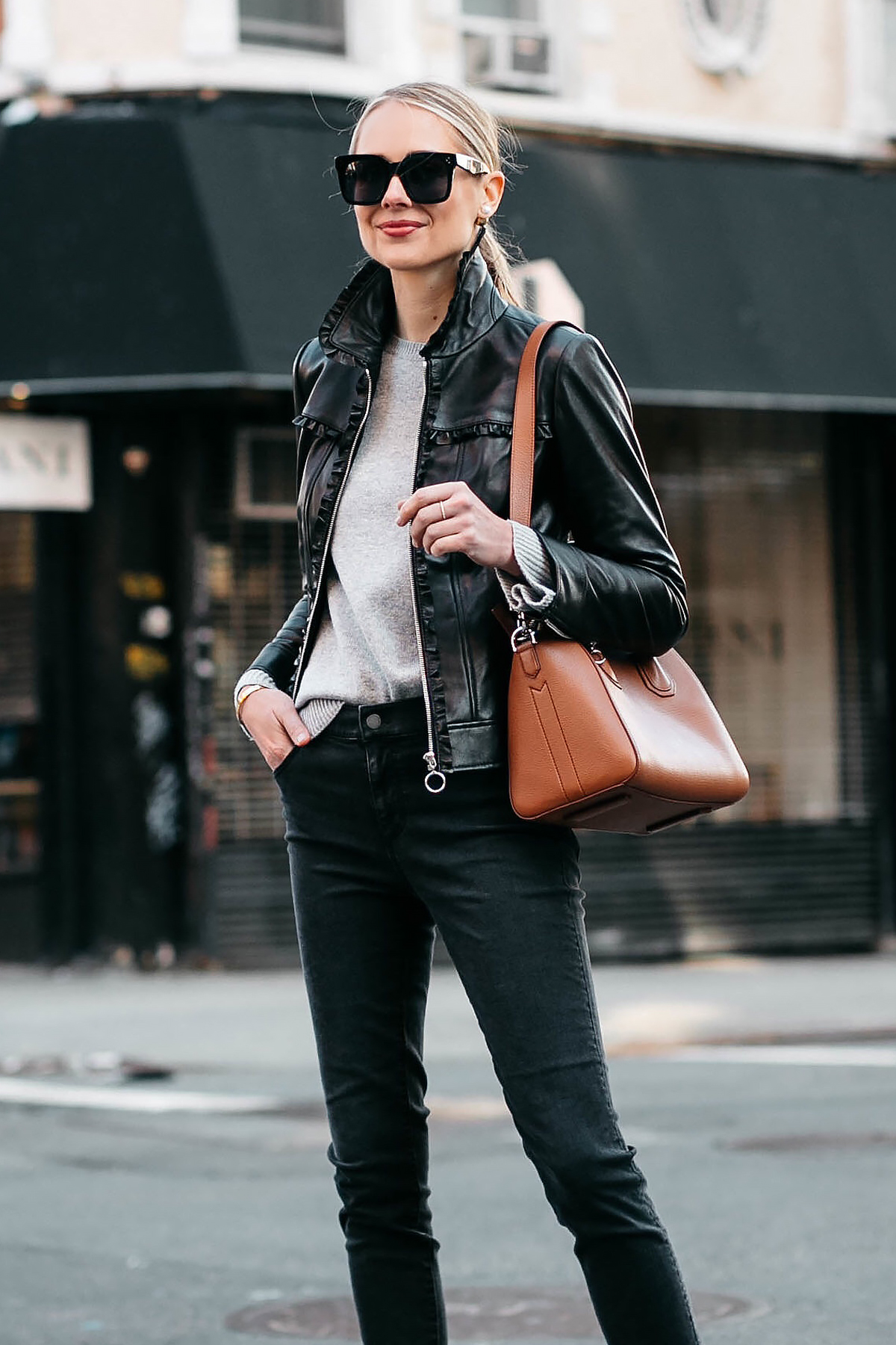 Blonde Woman Wearing Ann Taylor Black Leather Jacket Grey Sweater Black Skinny Jeans Fashion Jackson Dallas Blogger Fashion Blogger Street Style New York Fashion Week