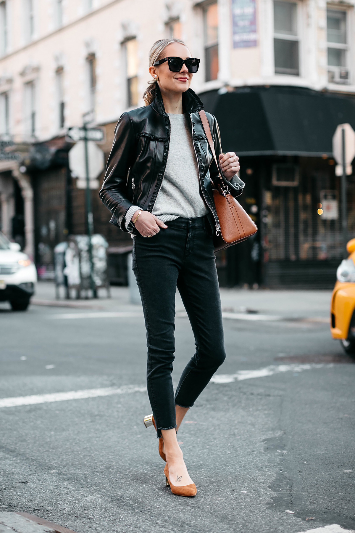 Blonde Woman Wearing Ann Taylor Black Leather Jacket Grey Sweater Black Skinny Jeans Tan Pumps Fashion Jackson Dallas Blogger Fashion Blogger Street Style New York Fashion Week