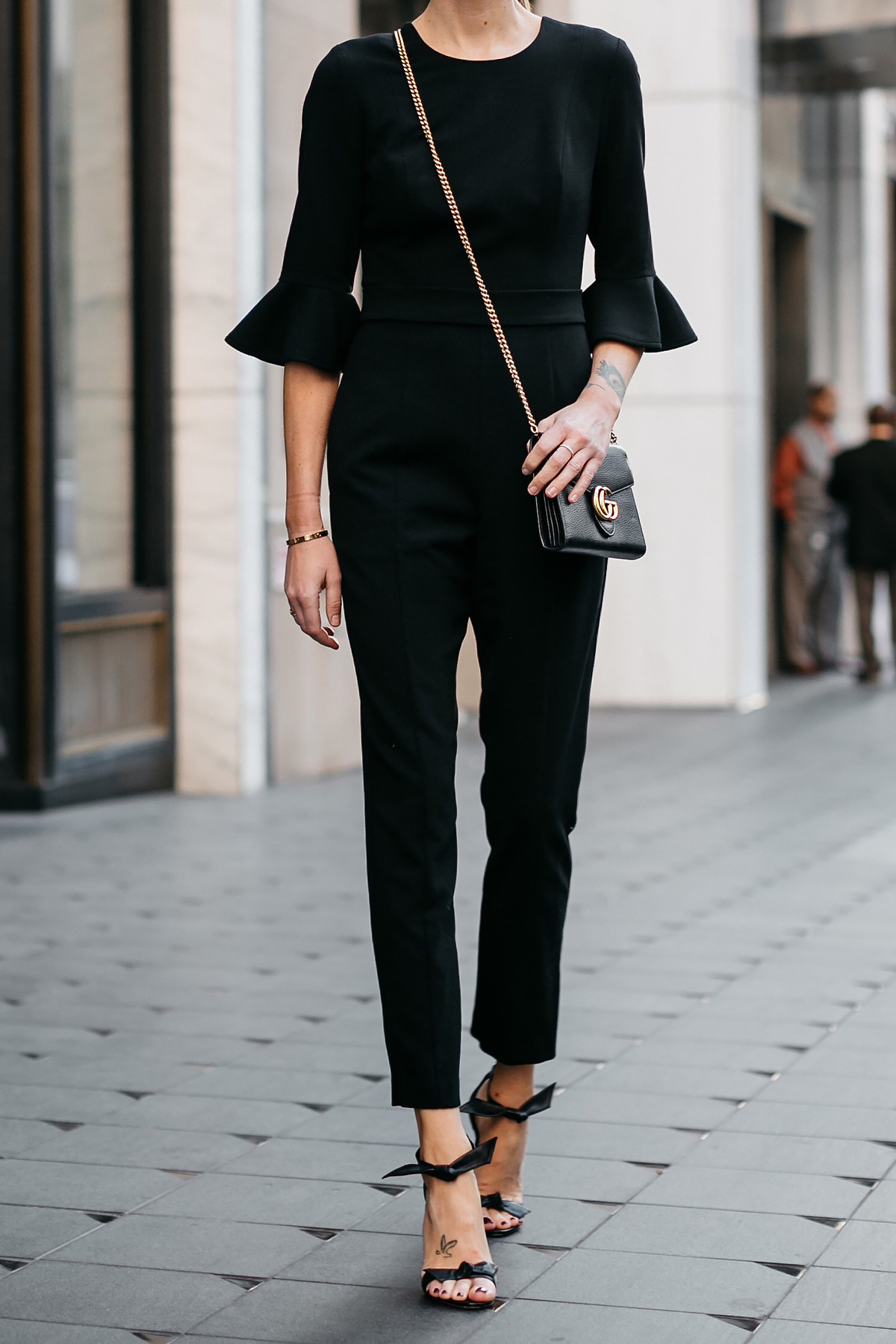 Woman Wearing Black Ruffle Sleeve Jumpsuit Gucci Marmont Black Handbag Black Bow Tie Heels Black Celine Sunglasses Fashion Jackson Dallas Blogger Fashion Blogger Street Style
