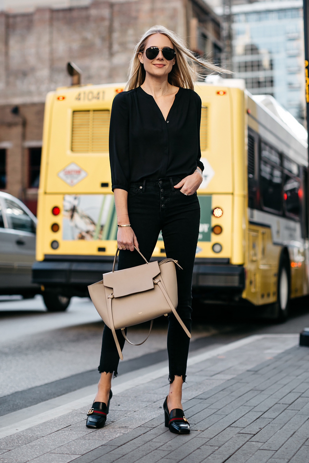 Blonde Woman Wearing Black Shirt Madewell Black Ripped Hem Skinny Jeans Gucci Black Peyton Block Heel Pumps Celine Belt Bag Celine Aviator Sunglasses Fashion Jackson Dallas Blogger Fashion Blogger Street Style