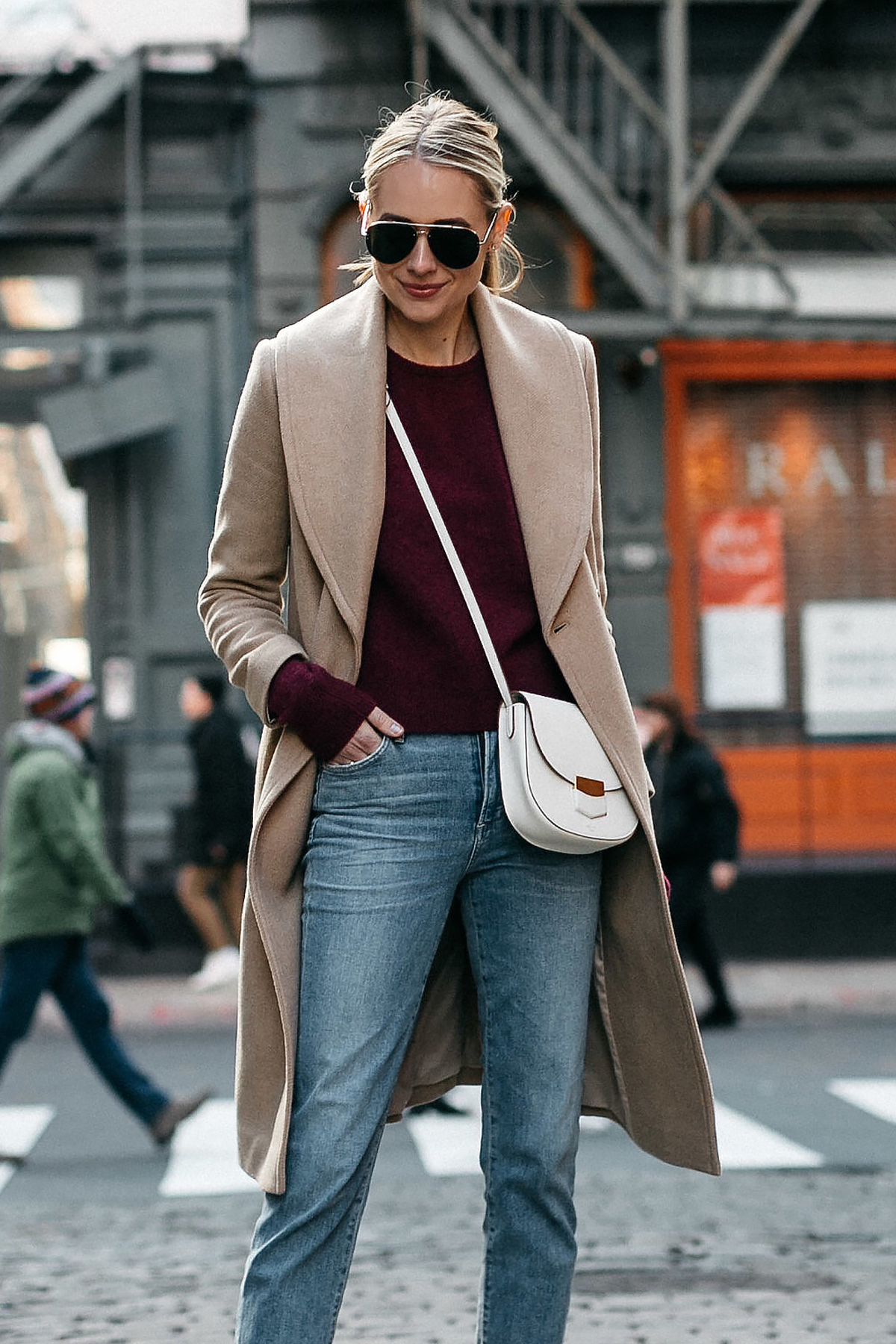 Blonde Woman Wearing Club Monaco Camel Coat Burgundy Sweater Denim Jeans Celine White Trotteur Handbag Fashion Jackson Dallas Blogger Fashion Blogger Street Style New York Fashion Week NYFW