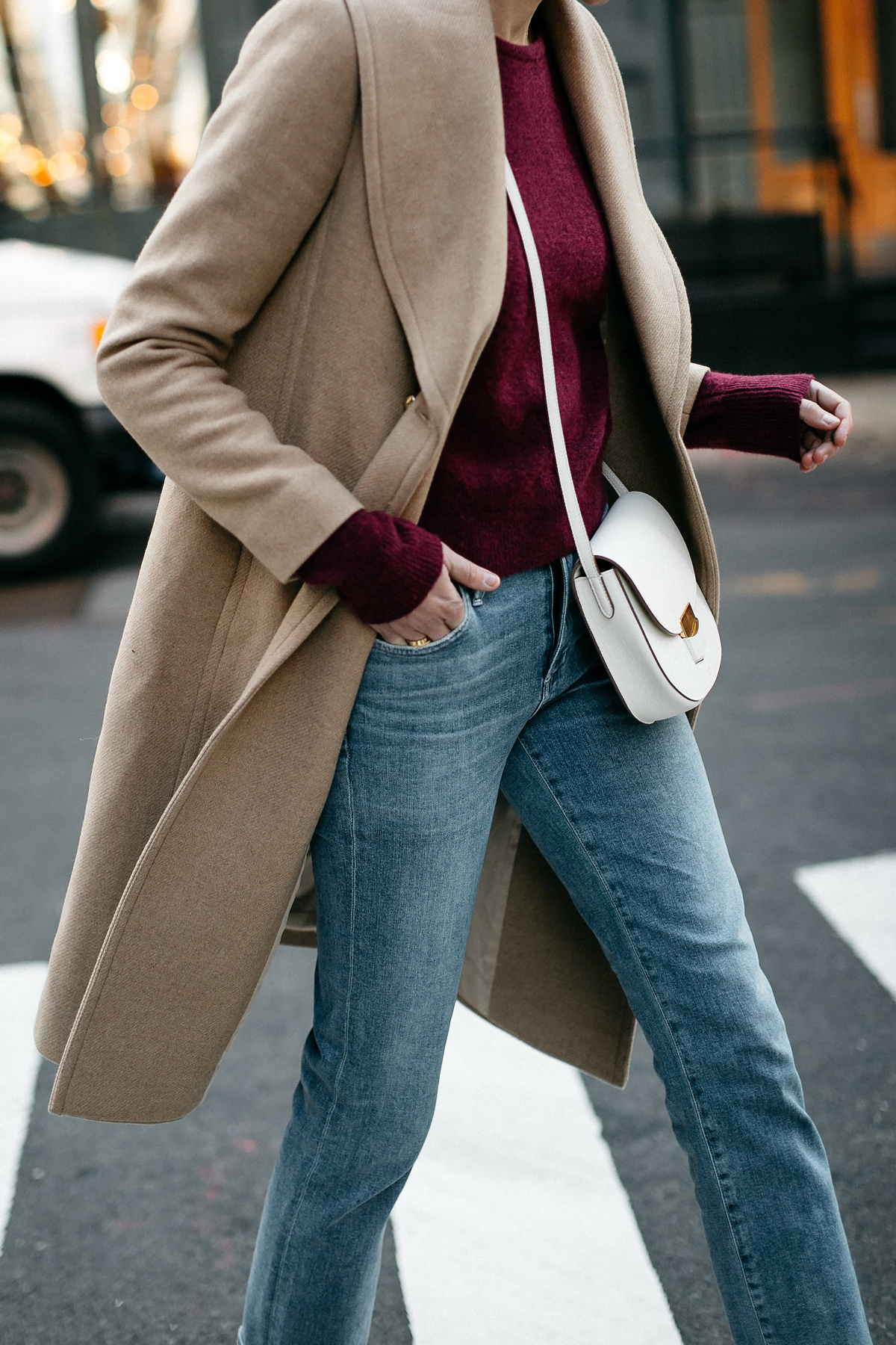 Woman Wearing Club Monaco Camel Coat Burgundy Sweater Denim Jeans White Celine Trotteur Handbag Fashion Jackson Dallas Blogger Fashion Blogger Street Style New York Fashion Week