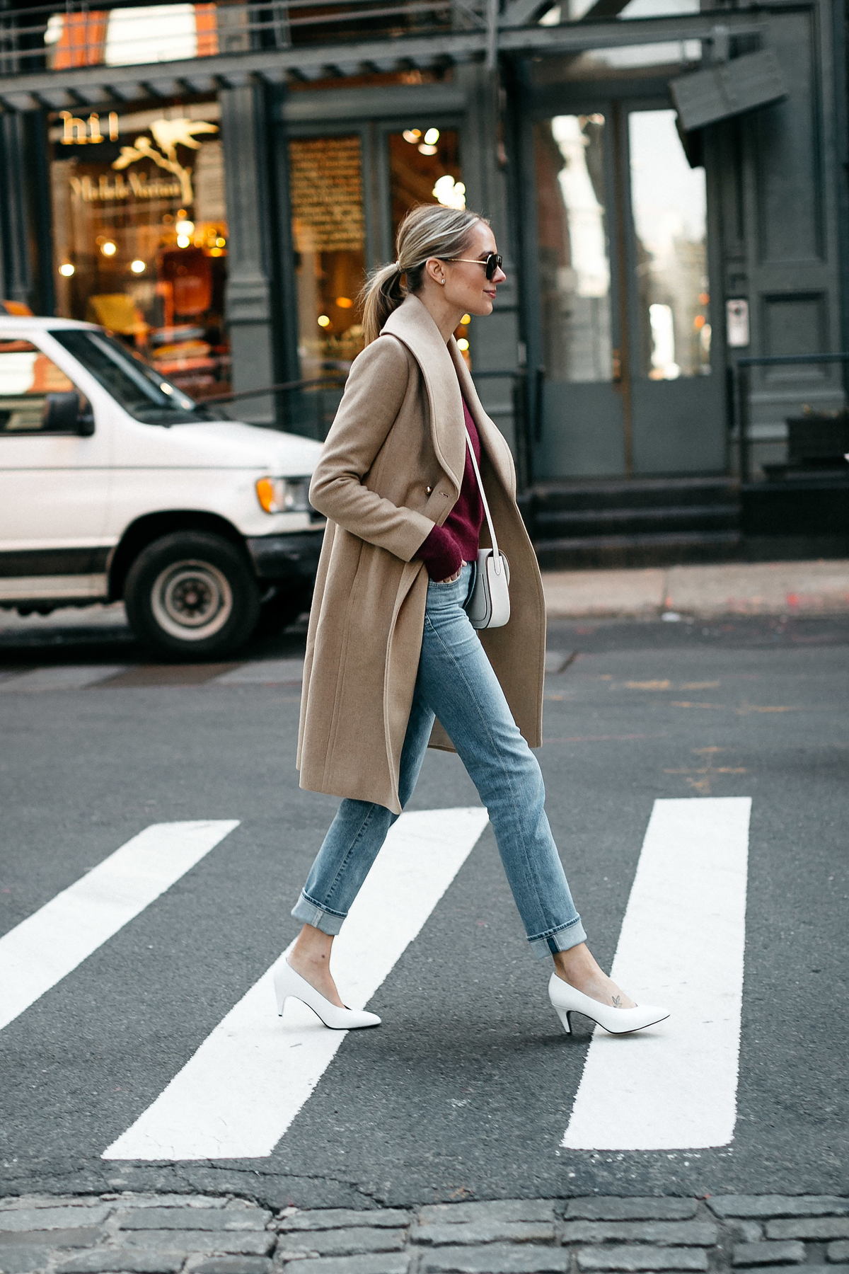 Blonde Woman Wearing Club Monaco Camel Coat Burgundy Sweater Denim Jeans White Pumps Fashion Jackson Dallas Blogger Fashion Blogger Street Style New York Fashion Week