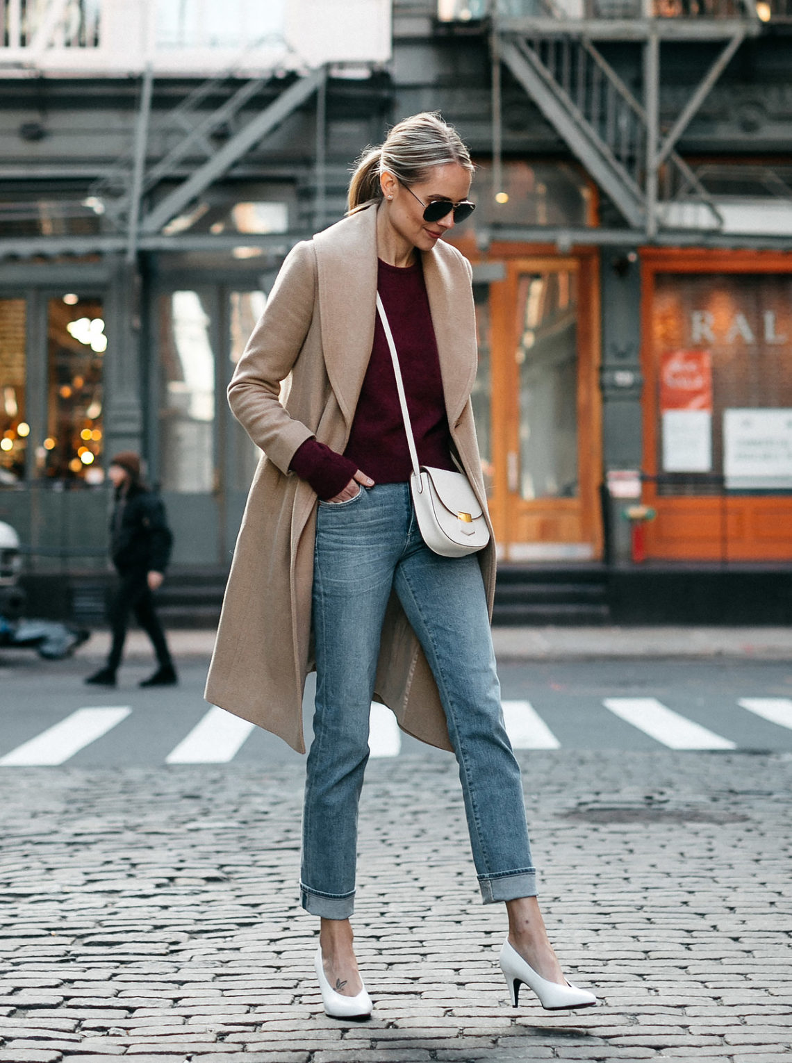 Blonde Woman Wearing Club Monaco Camel Coat Burgundy Sweater Denim Jeans White Pumps Celine White Trotteur Handbag Fashion Jackson Dallas Blogger Fashion Blogger Street Style New York Fashion Week