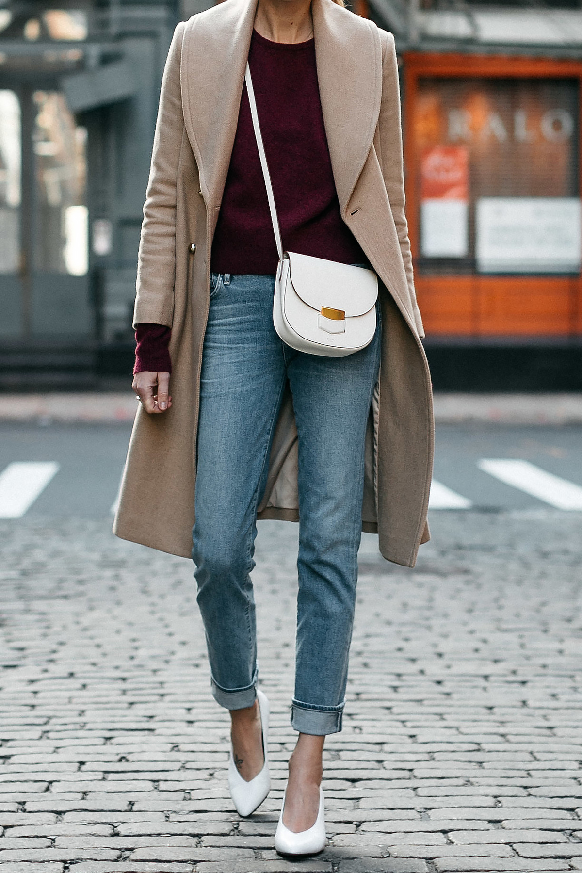 Woman Wearing Club Monaco Camel Coat Burgundy Sweater Denim Jeans White Pumps Celine White Trotteur Handbag Fashion Jackson Dallas Blogger Fashion Blogger Street Style New York Fashion Week