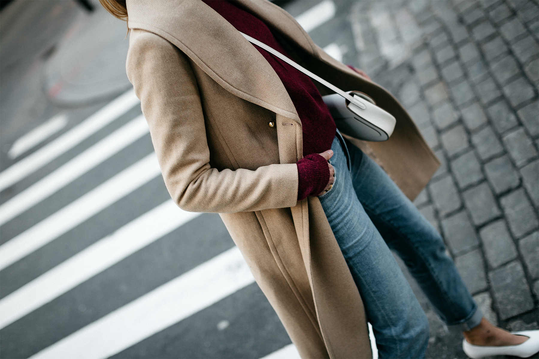 Woman Wearing Club Monaco Camel Coat Burgundy Sweater Denim Jeans White Pumps Fashion Jackson Dallas Blogger Fashion Blogger Street Style New York Fashion Week