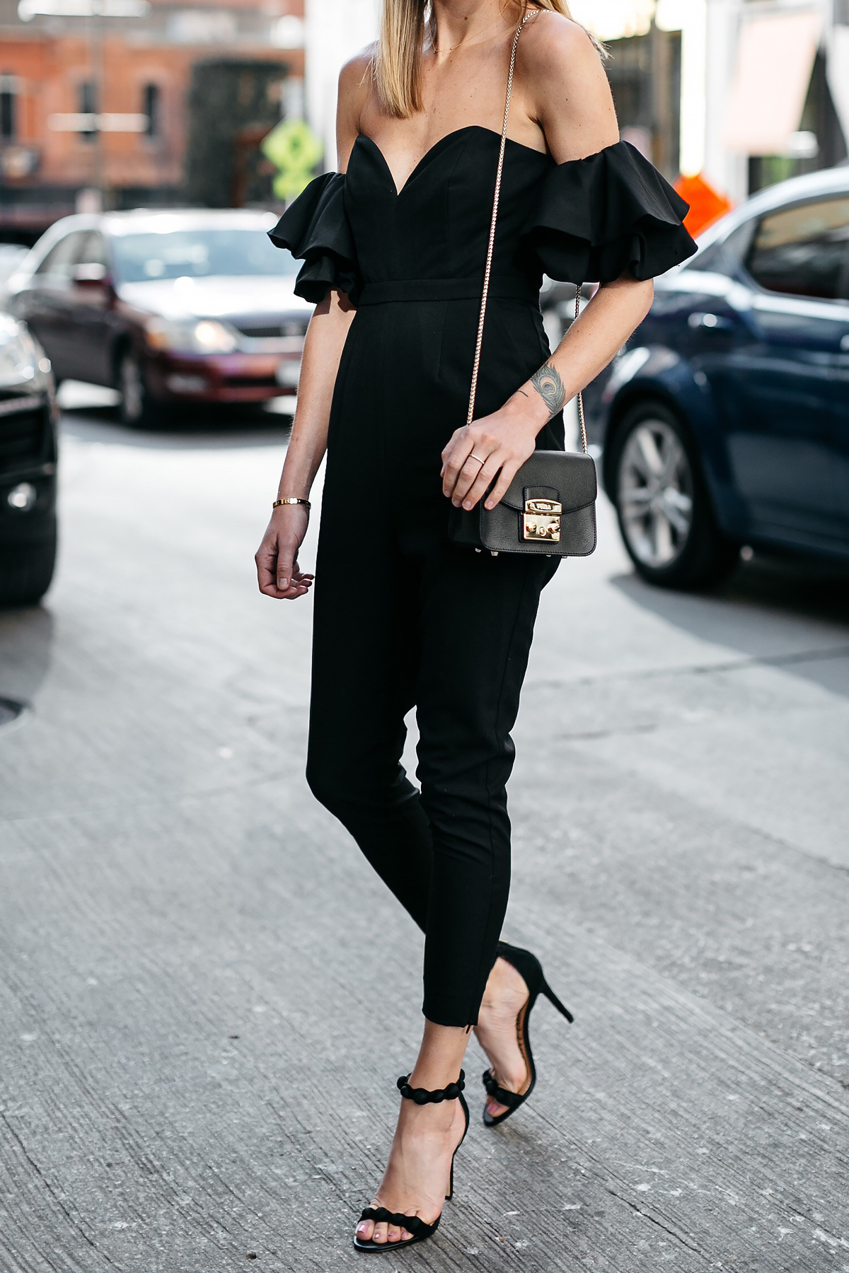 Woman Wearing Black off the Shoulder Jumpsuit Black Ankle Strap Heels Furla Black Handbag Fashion Jackson Dallas Blogger Fashion Blogger Street Style