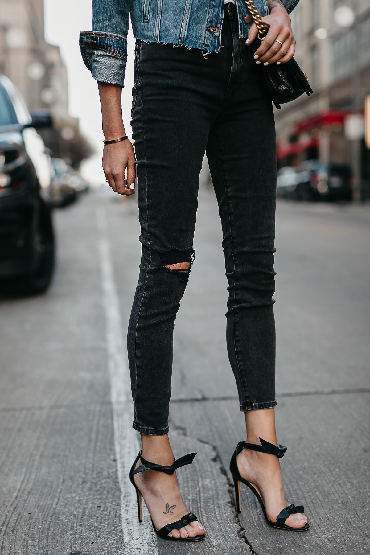 Blonde Woman Wearing Joes Jeans Black Ripped Skinny Jeans Denim Jacket Alexandre Birman Black Bow Heels Fashion Jackson Dallas Blogger Fashion Blogger Street Style