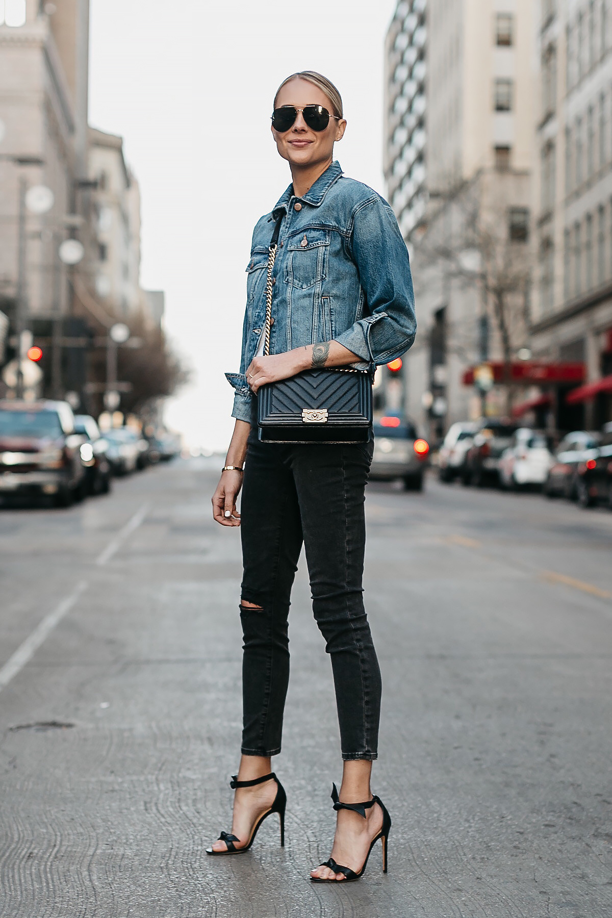 Blonde Woman Wearing Joes Jeans Black Ripped Skinny Jeans Denim Jacket Chanel Black Boy Bag Alexandre Birman Black Bow Heels Celine Aviator Sunglasses Fashion Jackson Dallas Blogger Fashion Blogger Street Style