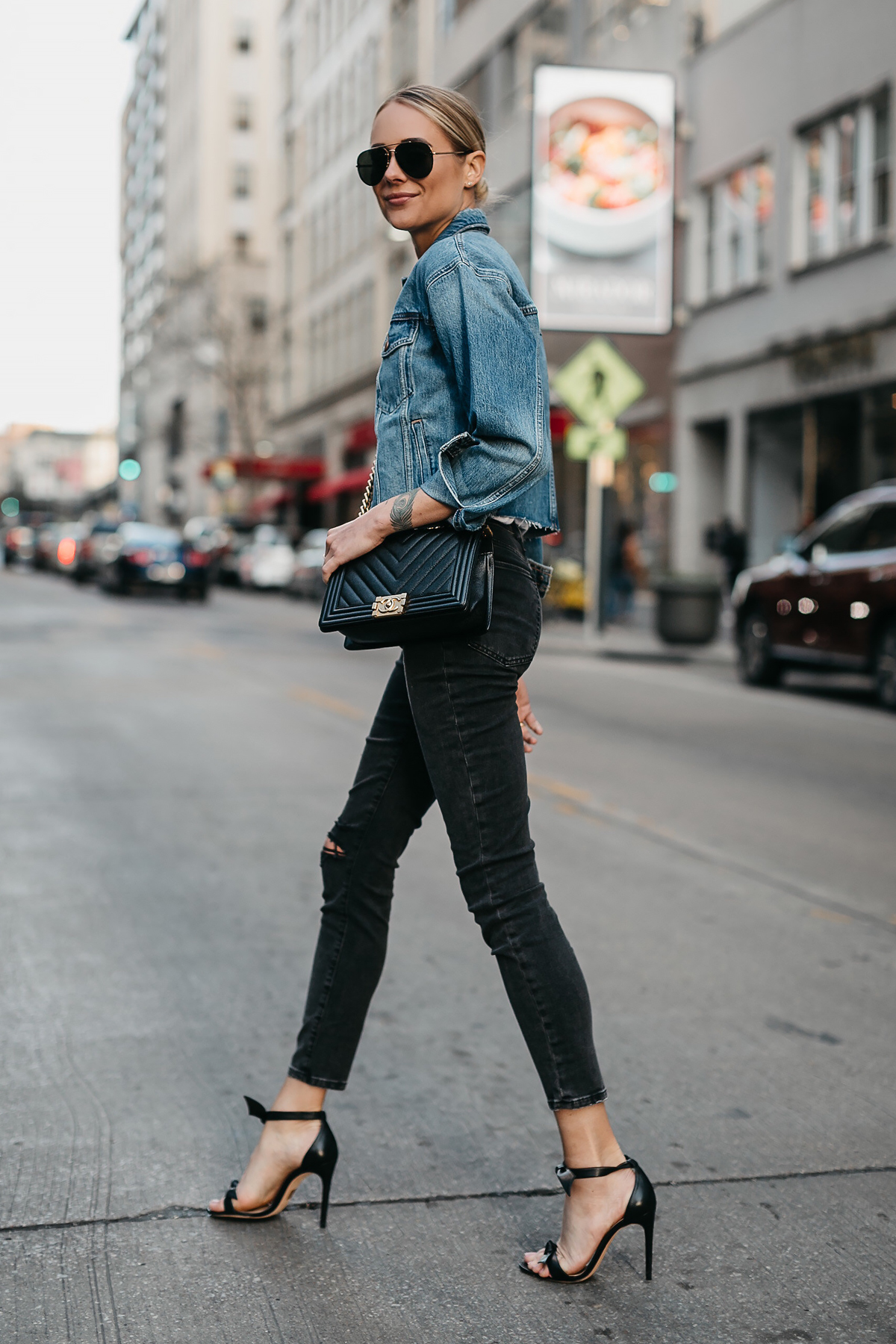 Blonde Woman Wearing Joes Jeans Black Ripped Skinny Jeans Denim Jacket Chanel Black Boy Bag Alexandre Birman Black Bow Heels Fashion Jackson Dallas Blogger Fashion Blogger Street Style