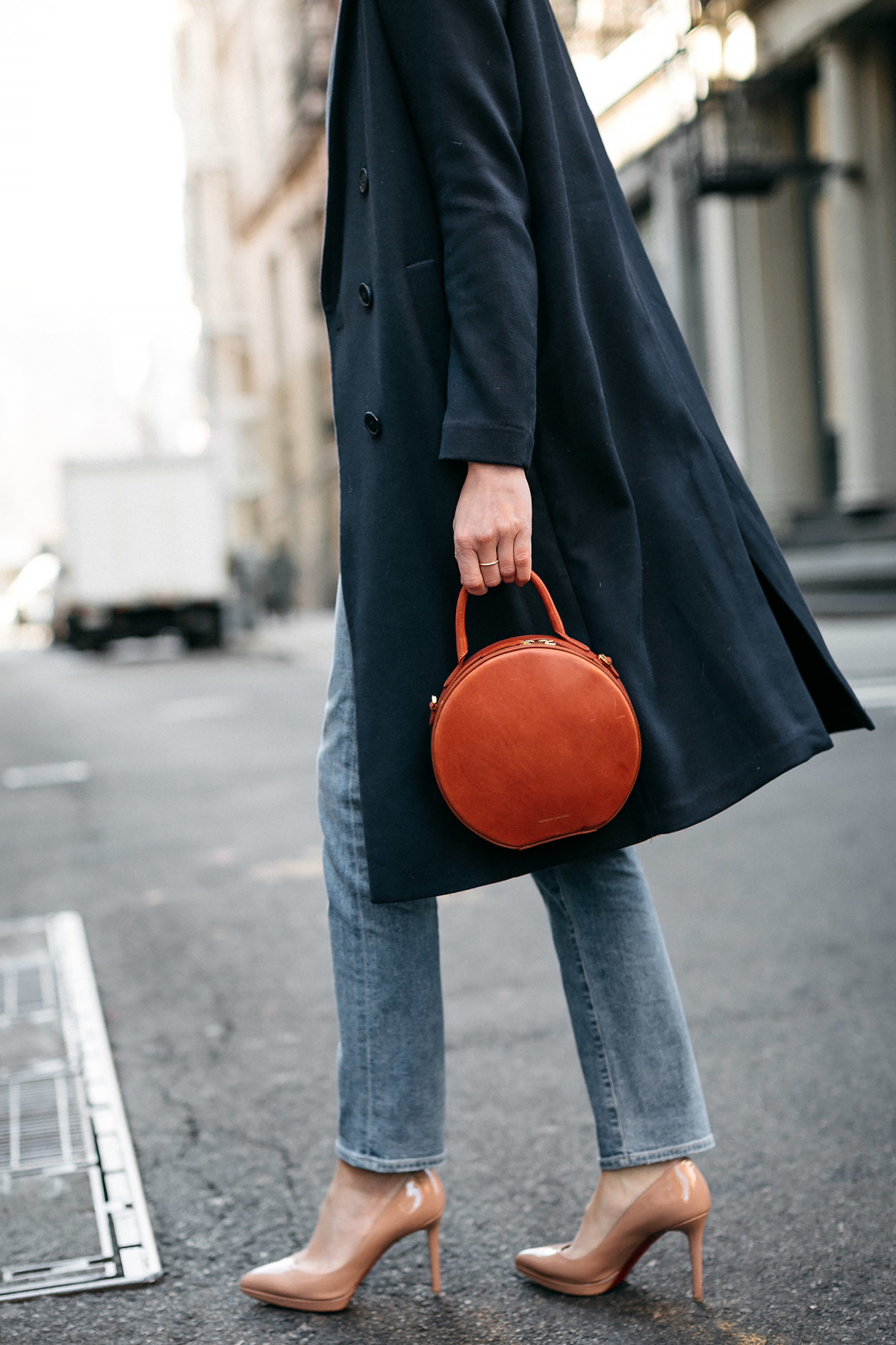 Woman Wearing Navy Wool Coat Denim Jeans Christian Louboutin Nude Pumps Mansur Gavriel Circle Handbag Fashion Jackson Dallas Blogger Fashion Blogger Street Style NYFW