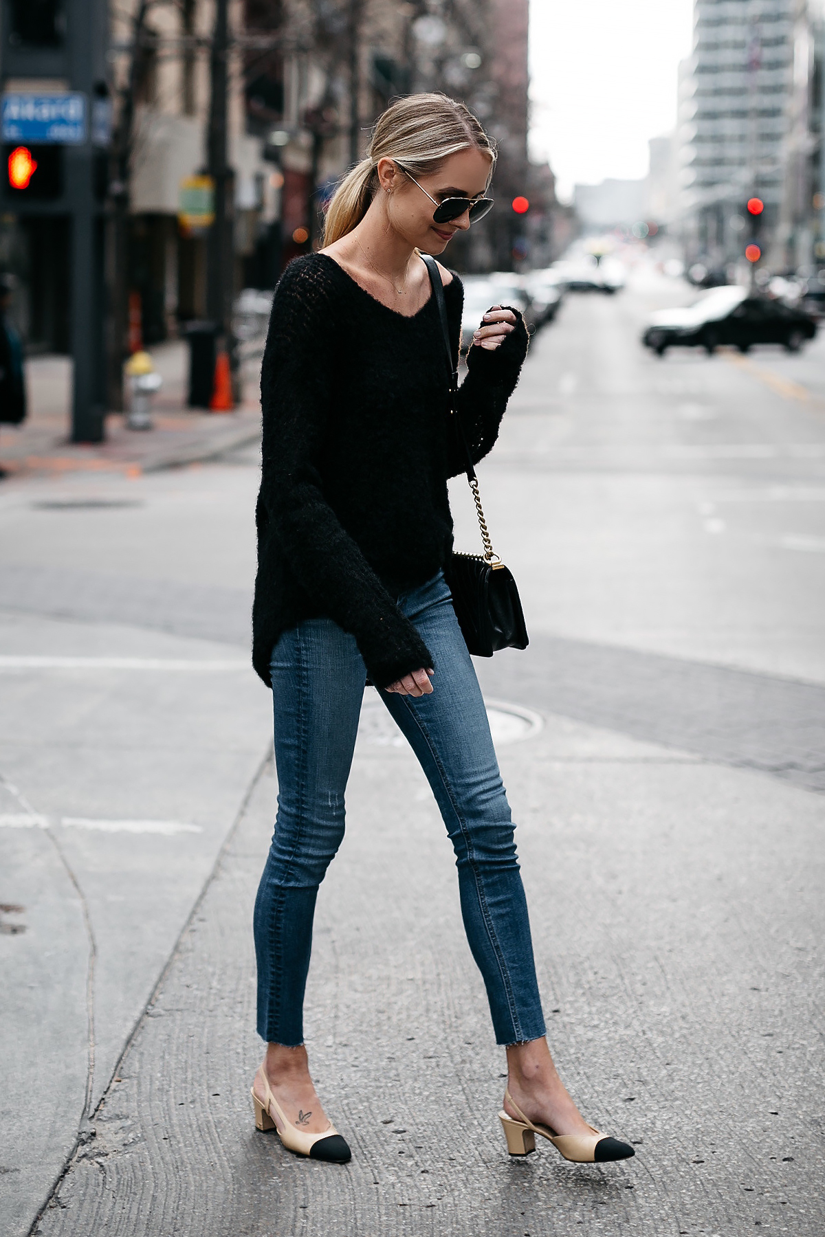 Blonde Woman Wearing rag and bone Black Sweater Denim Skinny Jeans Chanel Slinbacks Fashion Jackson Dallas Blogger Fashion Blogger Street Style