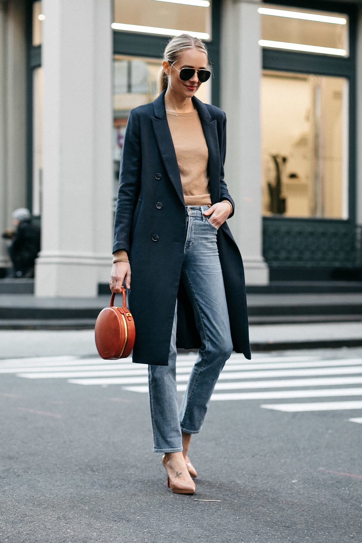 Blonde Woman Wearing Navy Wool Coat Everlane Camel Sweater Relaxed Denim Jeans Christian Louboutin Nude Pumps Mansur Gavriel Circle Handbag Celine Aviator Sunglasses Fashion Jackson Dallas Blogger Fashion Blogger Street Style NYFW
