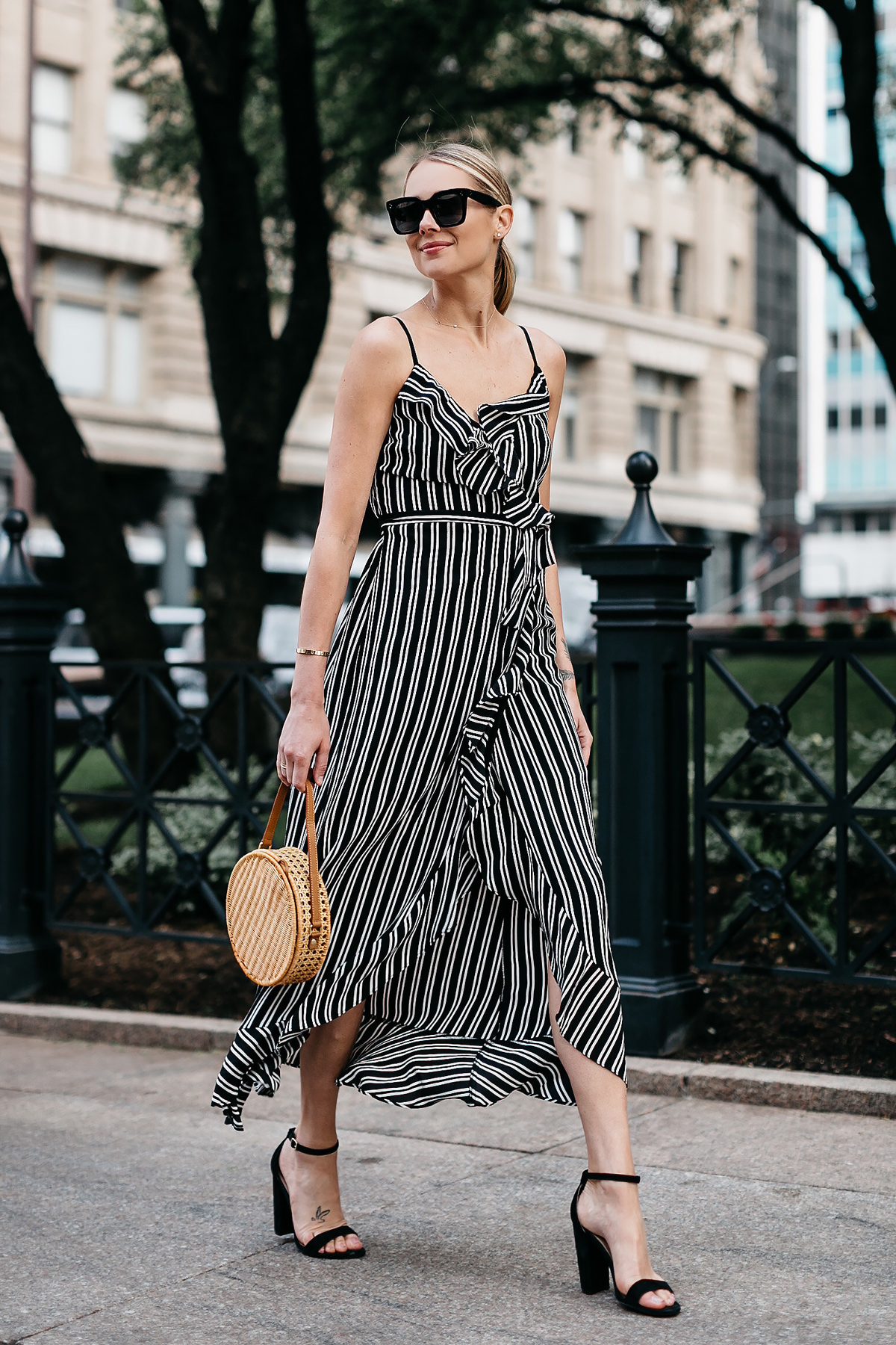 Blonde Woman Wearing AQUA Black White Stripe Maxi Dress Circle Straw Basket Handbag Black Ankle Strap Heeled Sandals Fashion Jackson Dallas Blogger Fashion Blogger Street Style