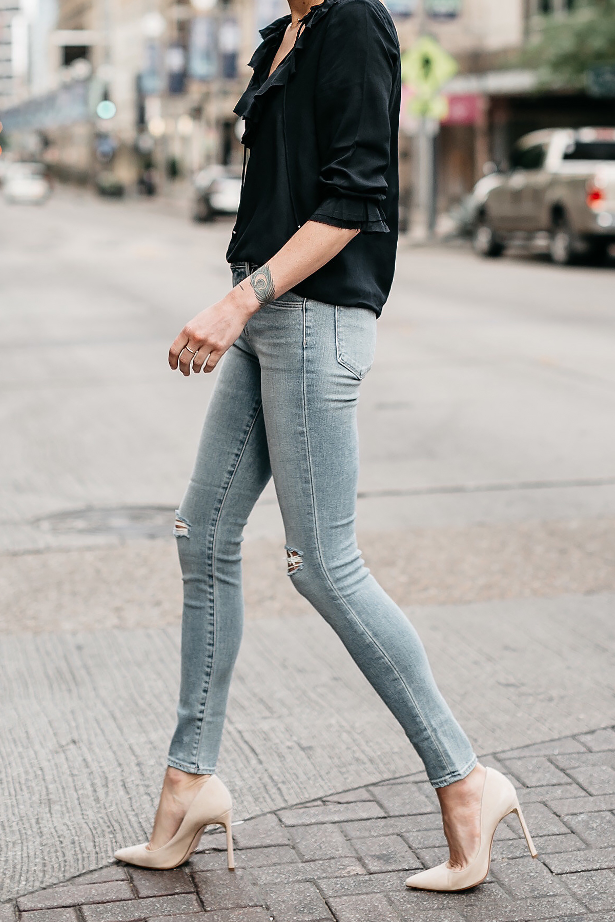 Woman Wearing Black Ruffle Top Denim Ripped Skinny Jeans Nude Pumps Fashion Jackson Dallas Blogger Fashion Blogger Street Style