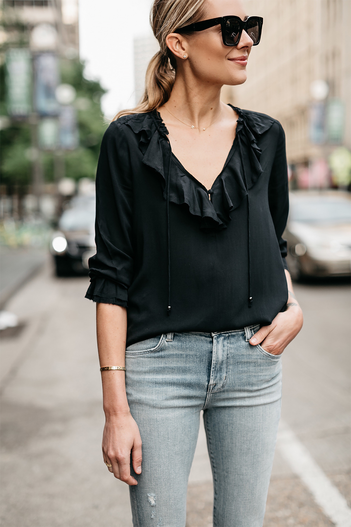 Blonde Woman Wearing Black Ruffle Top Denim Ripped Skinny Jeans Fashion Jackson Dallas Blogger Fashion Blogger Street Style
