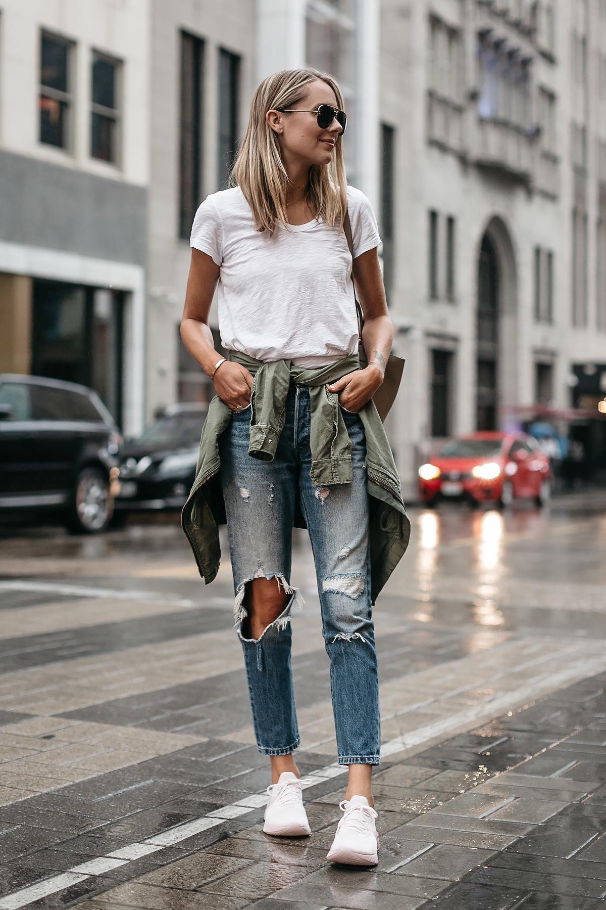 Blonde Woman Wearing Nike React Running Shoe White Tshirt Ripped Denim Jeans Green Utility Jacket Fashion Jackson Dallas Blogger Fashion Blogger Street Style
