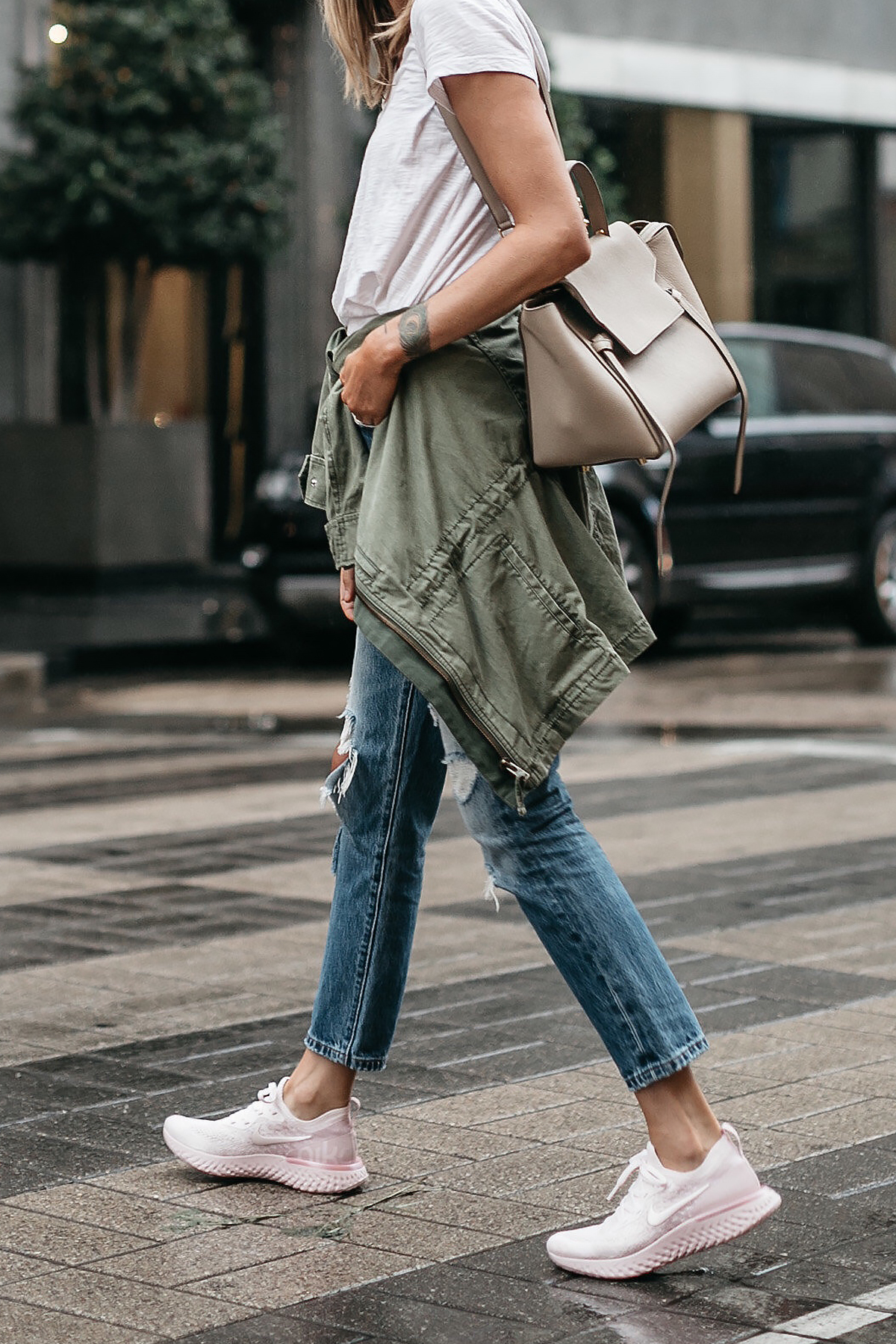 new arrival 9c84d 2bdf7 Woman Wearing Nike React Running Shoe White Tshirt Ripped Denim Jeans Green  Utility Jacket Celine Mini