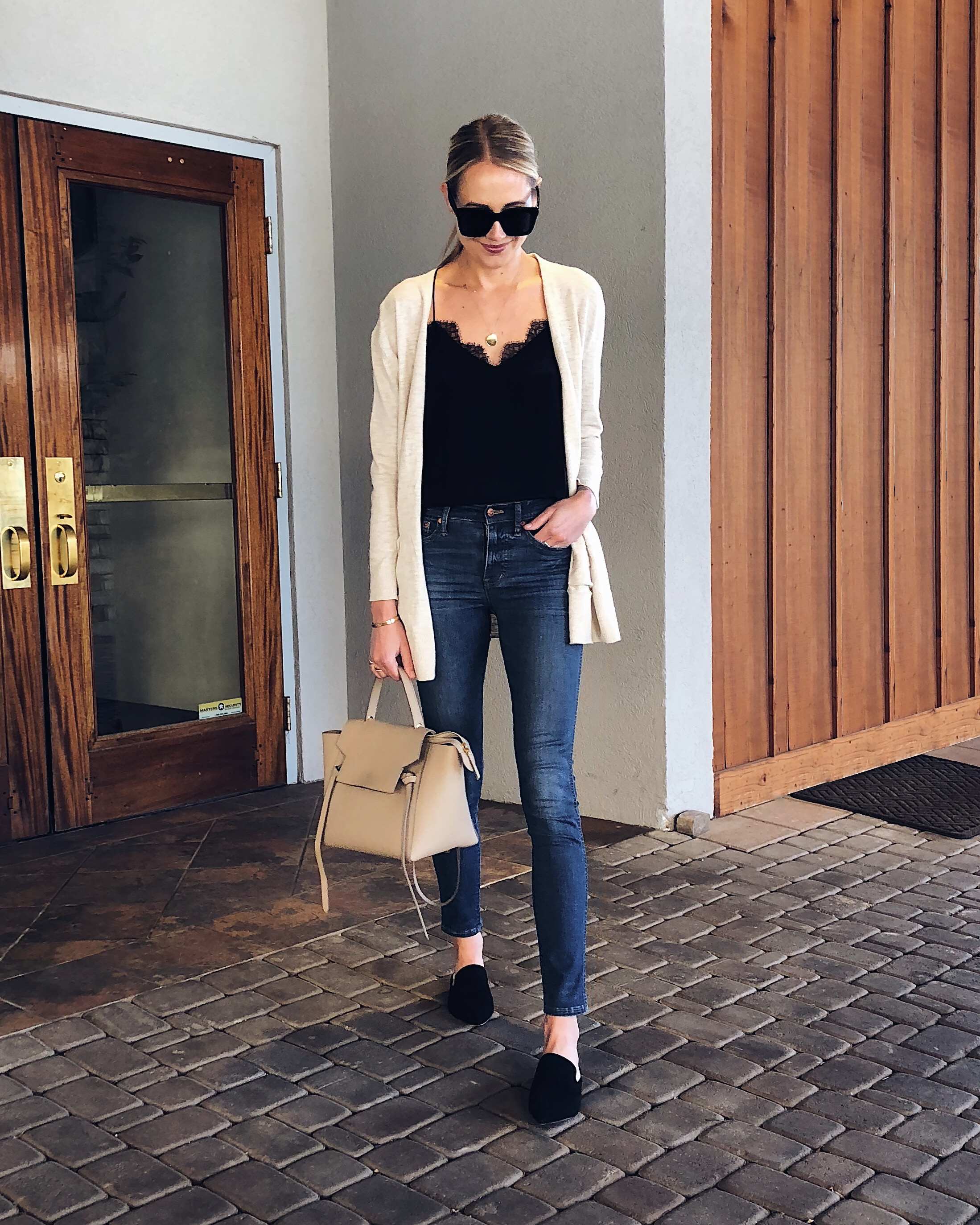 Blonde Woman Wearing Tan Cardigan Black Lace Cami Denim Skinny Jeans Black Mules Fashion Jackson Dallas Blogger Fashion Blogger Street Style