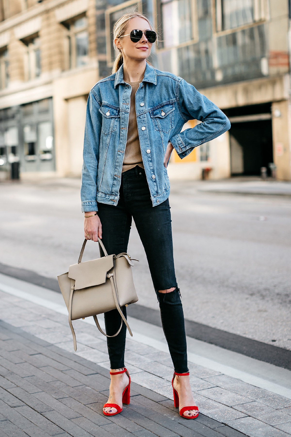 Blonde Woman Wearing Topshop Oversized Denim Jacket Tan Sweater Black Ripped Skinny Jeans Celine Mini Belt Bag Celine Aviator Sunglasses Red Ankle Strap Heeled Sandals Fashion Jackson Dallas Blogger Fashion Blogger Street Style