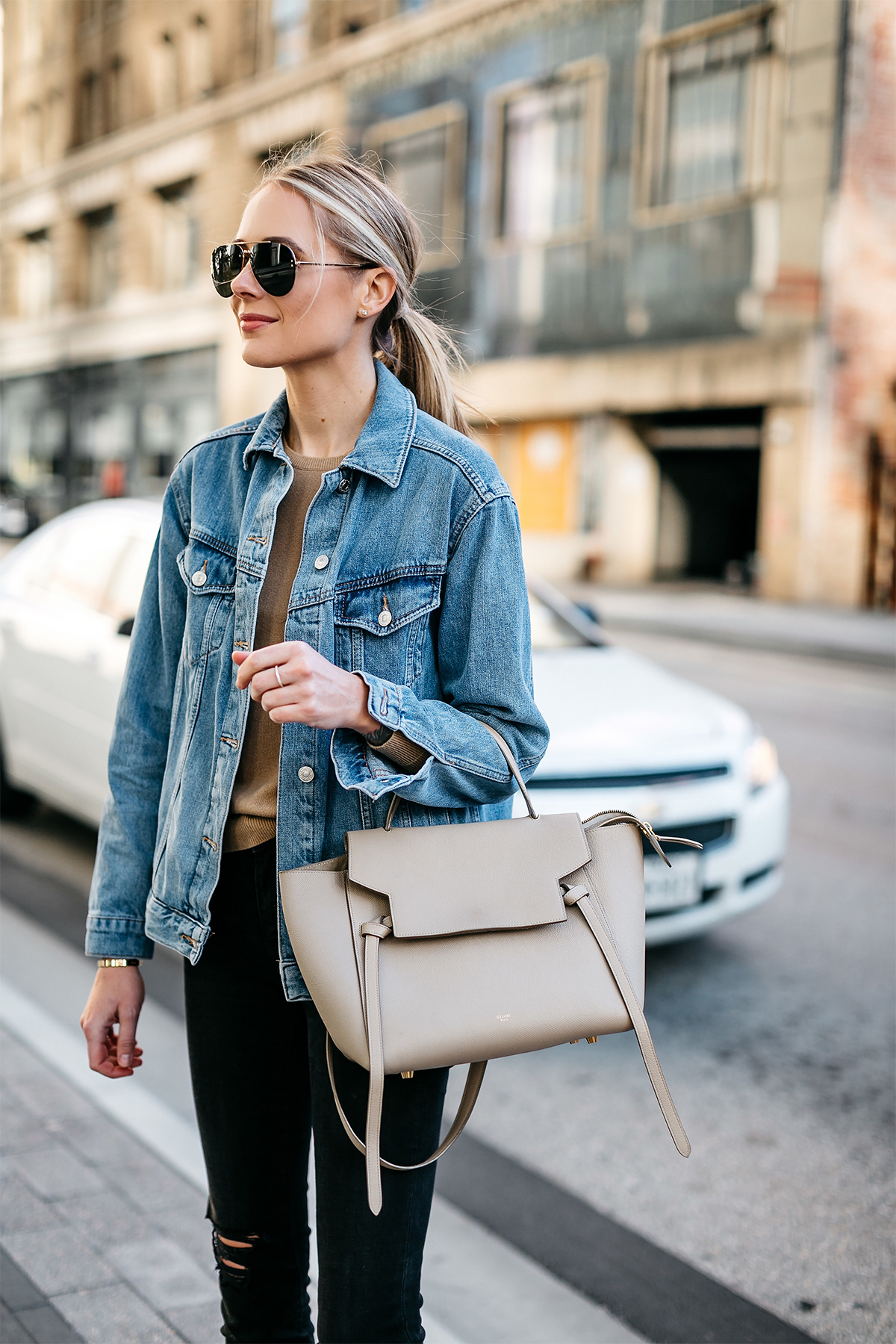 Blonde Woman Wearing Topshop Oversized Denim Jacket Tan Sweater Black Ripped Skinny Jeans Celine Mini Belt Bag Celine Aviator Sunglasses Fashion Jackson Dallas Blogger Fashion Blogger Street Style