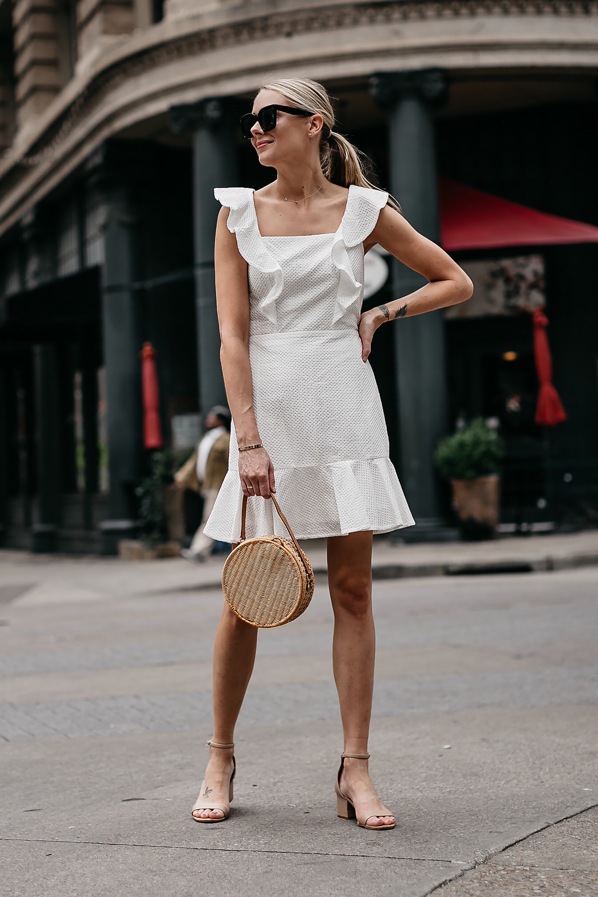 Blonde Woman Wearing Bloomingdales White Eyelet Ruffle Dress Circle Straw Handbag Tan Ankle Strap Sandals Fashion Jackson Dallas Blogger Fashion Blogger Street Style