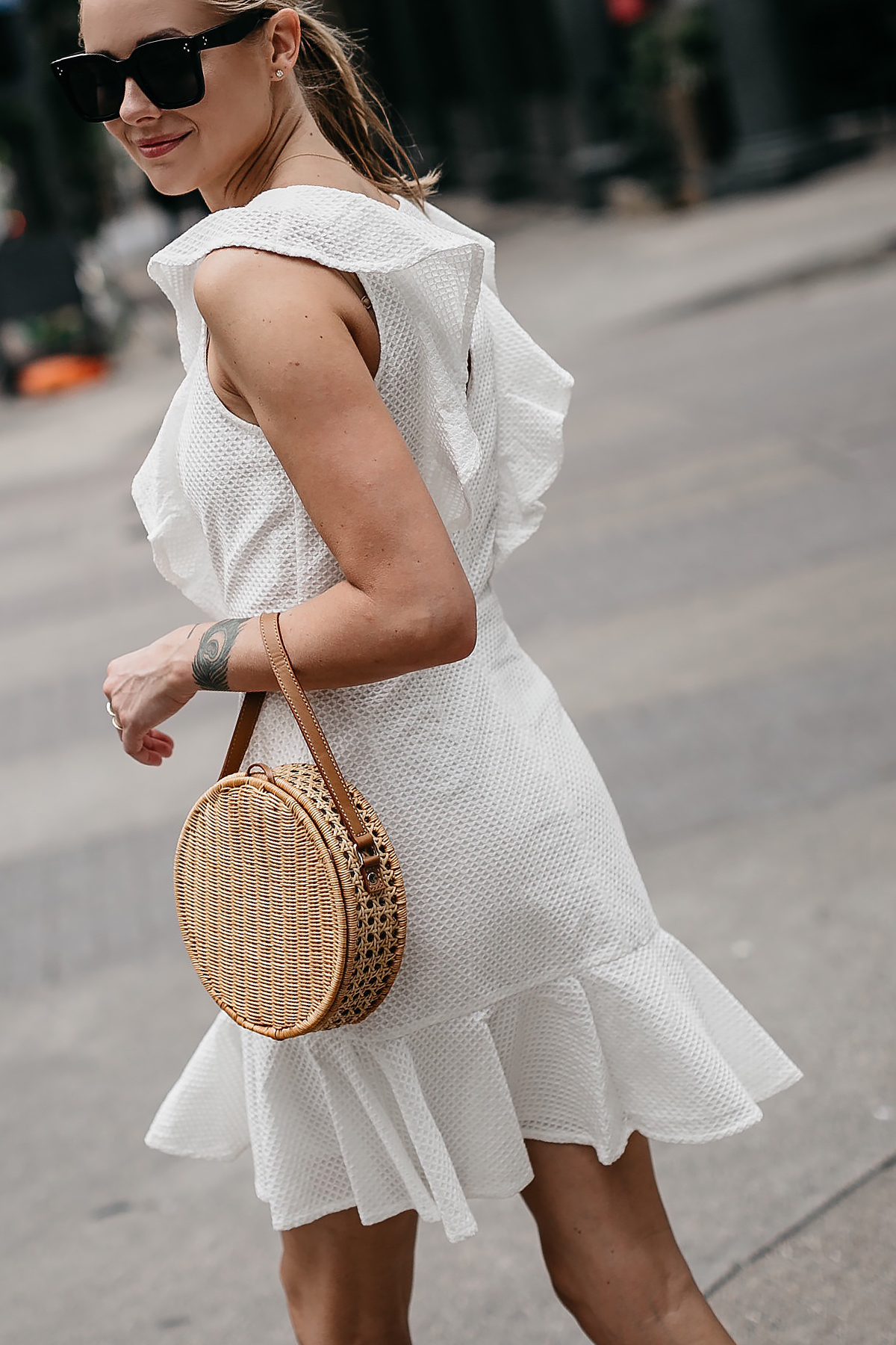 Blonde Woman Wearing Bloomingdales White Eyelet Ruffle Dress Circle Straw Handbag Fashion Jackson Dallas Blogger Fashion Blogger Street Style