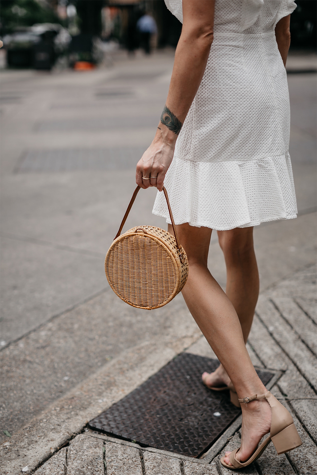 Woman Wearing White Eyelet Dress Circle Straw Handbag Tan Ankle Strap Sandals Fashion Jackson Dallas Blogger Fashion Blogger Street Style
