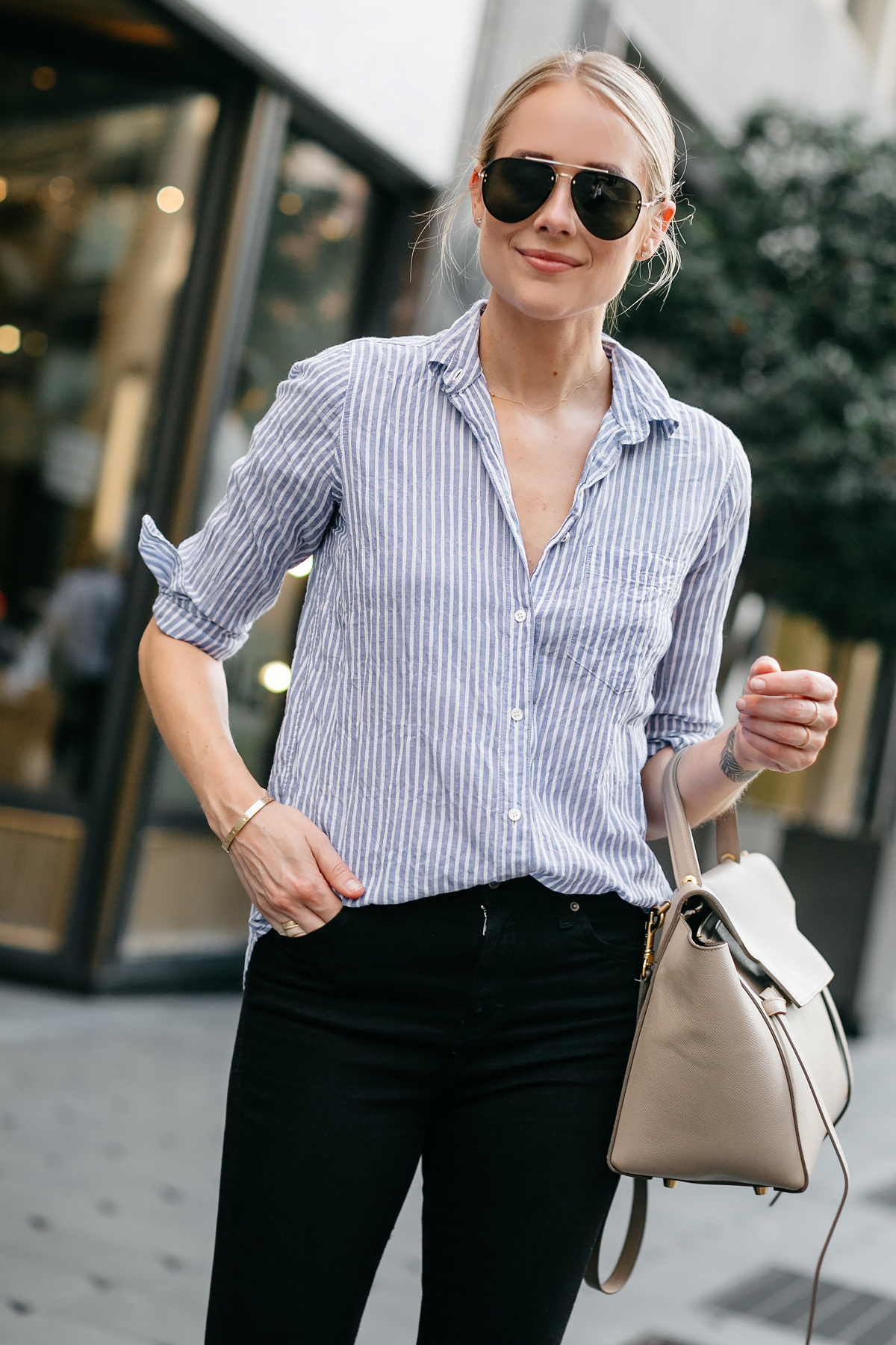 Blonde Woman Wearing Blue White Stripe Collared Shirt Black Skinny Jeans Celine Mini Belt Bag Celine Aviator Sunglasses Fashion Jackson Dallas Blogger Fashion Blogger Street Style