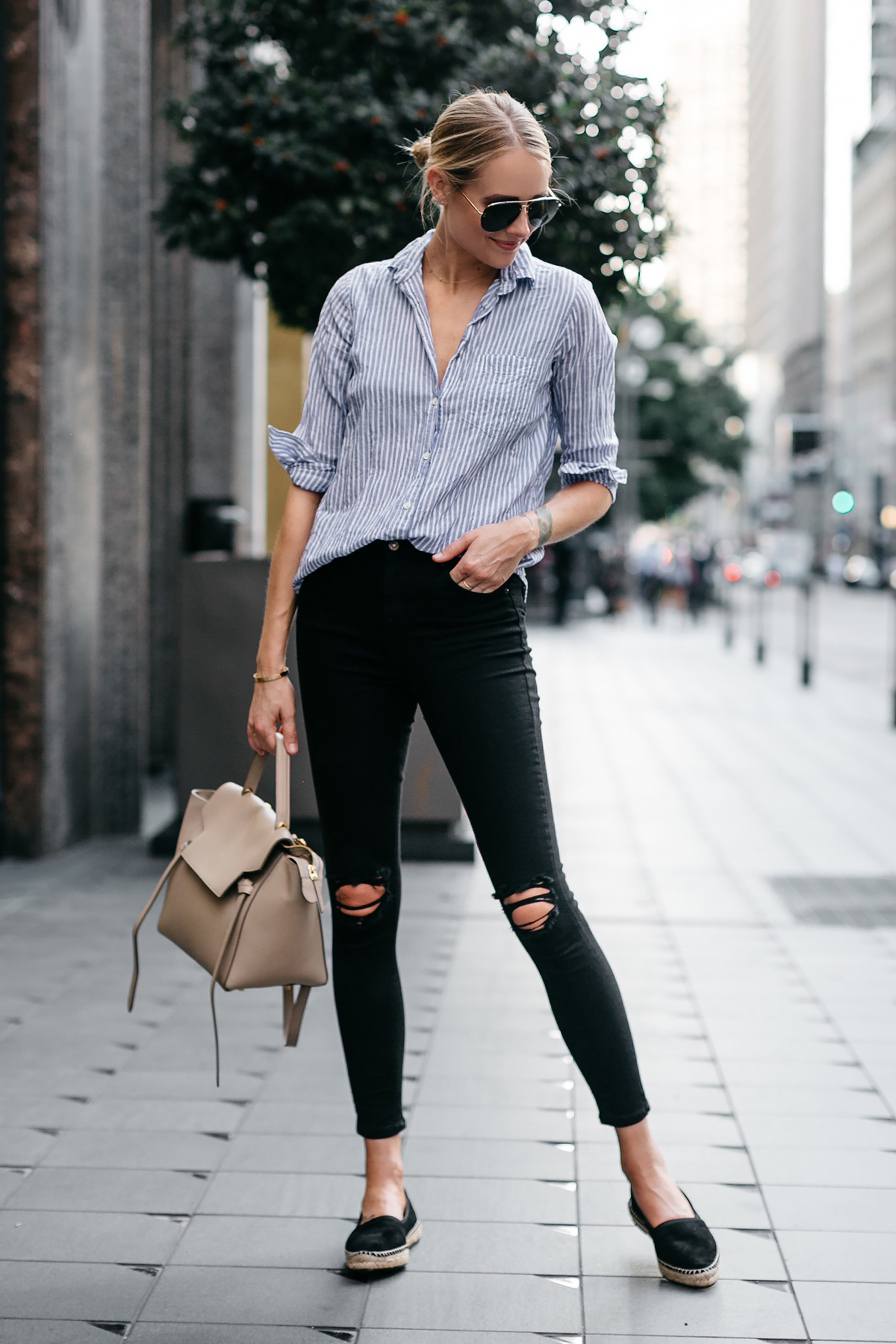 Blonde Woman Wearing Blue White Stripe Shirt Black Ripped Skinny Jeans Celine Mini Belt Bag Stuart Weitzman Black Espadrilles Fashion Jackson Dallas Blogger Fashion Blogger Street Style