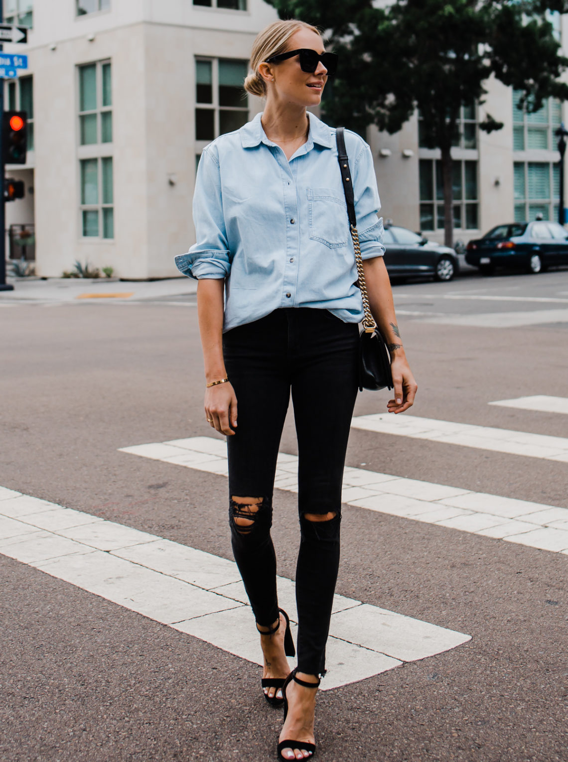 Blonde Woman Wearing Topshop Oversized Denim Shirt Topshop Black Ripped Skinny Jeans Steve Madden Black Ankle Strap Heeled Sandals Fashion Jackson San Diego Blogger Fashion Blogger Street Style