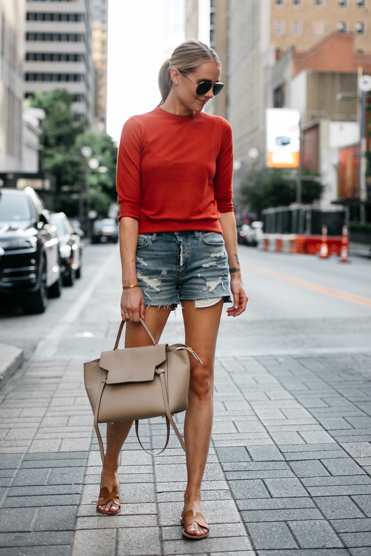 Blonde Woman Wearing Vince Red Orange Sweater Denim Ripped Shorts Celine MIni Belt Bag Tan Ancient Greece Sandals Celine Aviator Sunglasses Fashion Jackson Dallas Blogger Fashion Blogger Street Style
