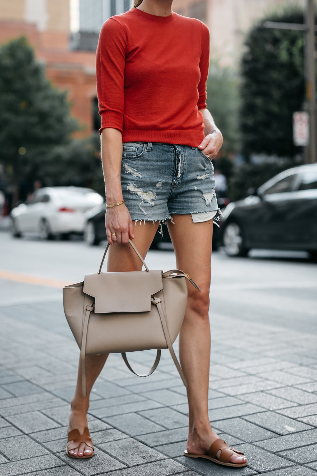 Woman Wearing Vince Red Orange Sweater Denim Ripped Shorts Celine MIni Belt Bag Tan Ancient Greece Sandals Fashion Jackson Dallas Blogger Fashion Blogger Street Style