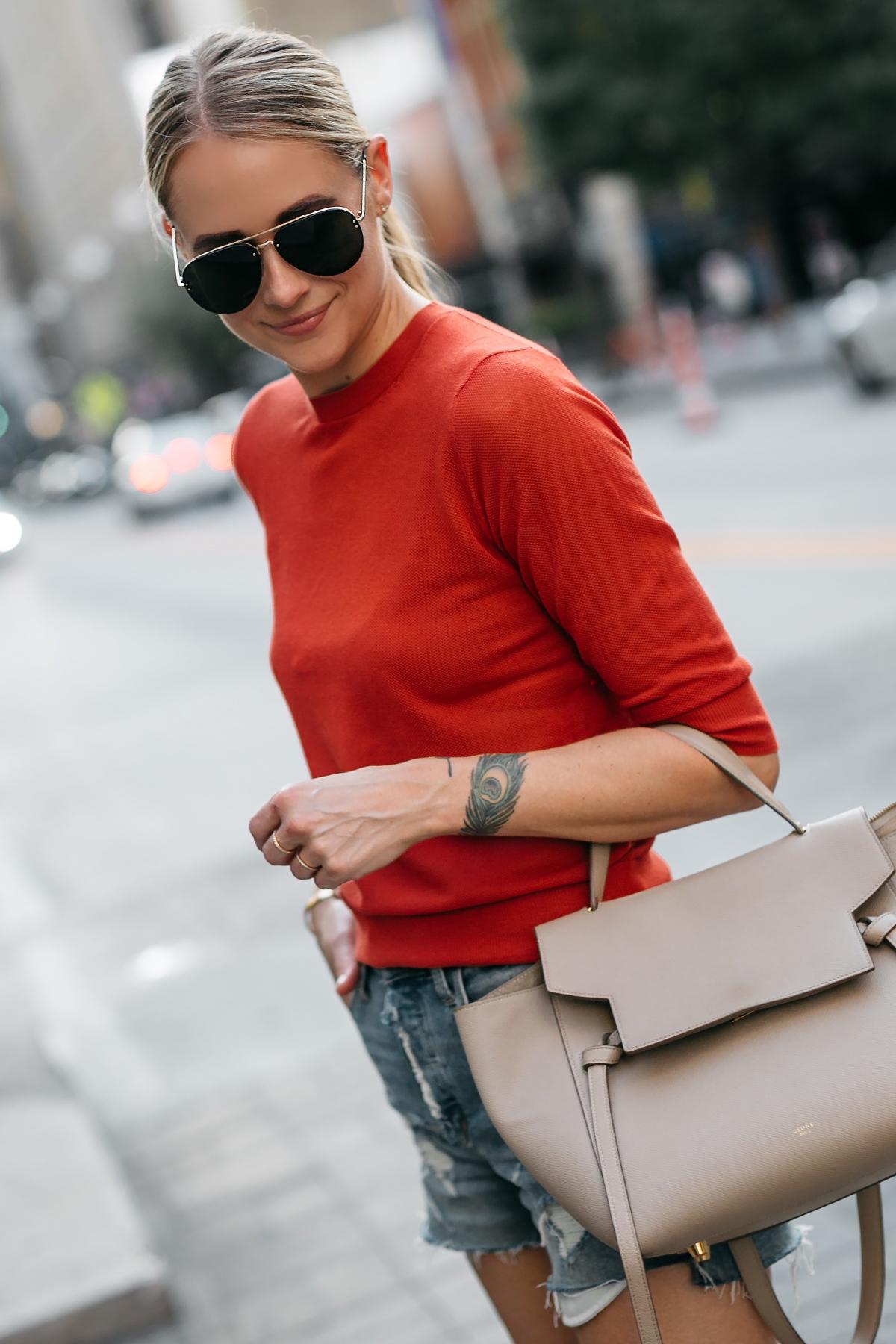 Blonde Woman Wearing Vince Red Orange Sweater Denim Ripped Shorts Celine Mini Belt Bag Celine Aviator Sunglasses Fashion Jackson Dallas Blogger Fashion Blogger Street Style