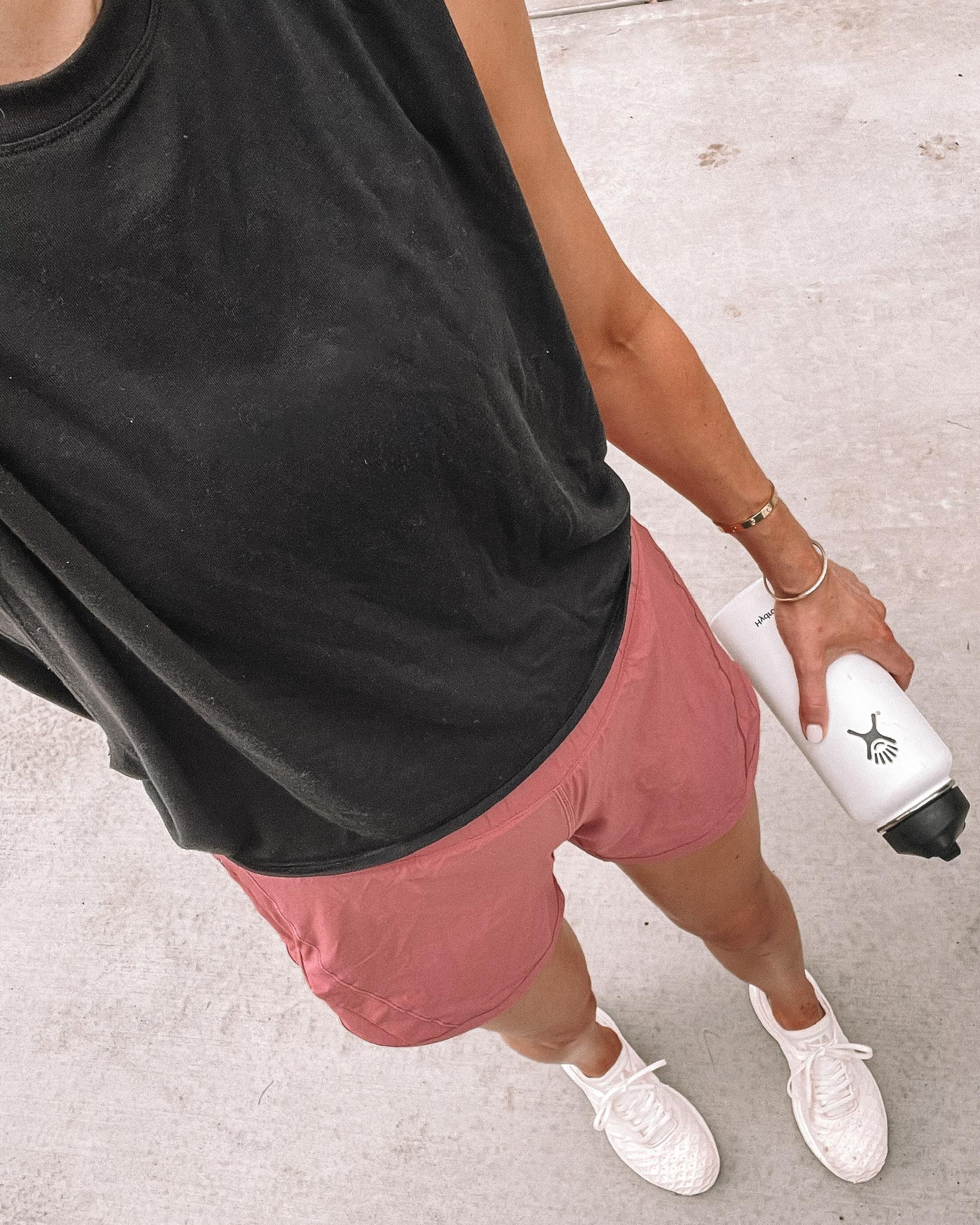 Fashion Jackson Wearing Athleta Black Tank lululemon Pink Running Shorts APL Sneakers workout outfits for women