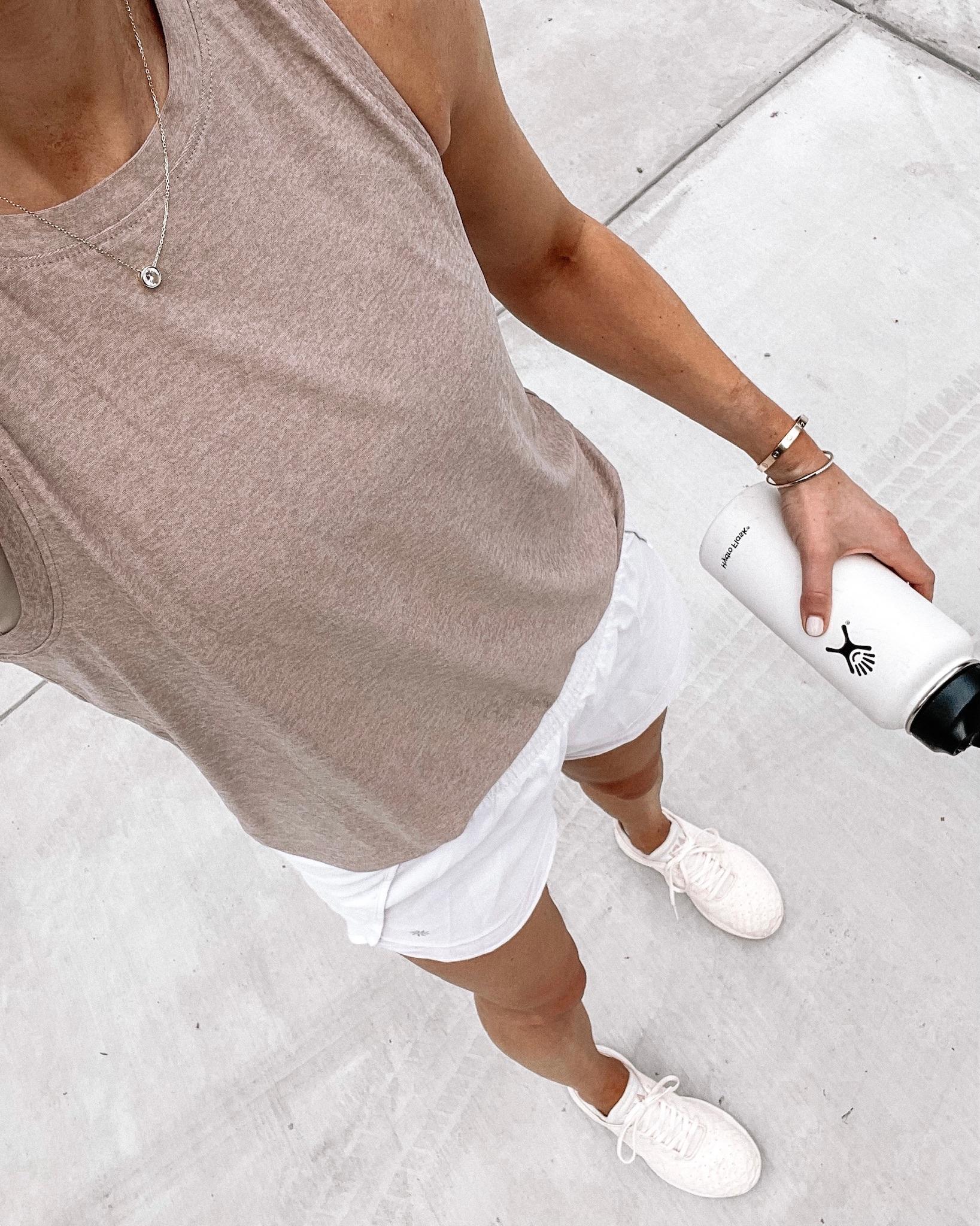 Fashion Jackson Wearing Beyond Yoga Beige Tank Athleta White Running Shorts APL Sneakers workout outfits for women