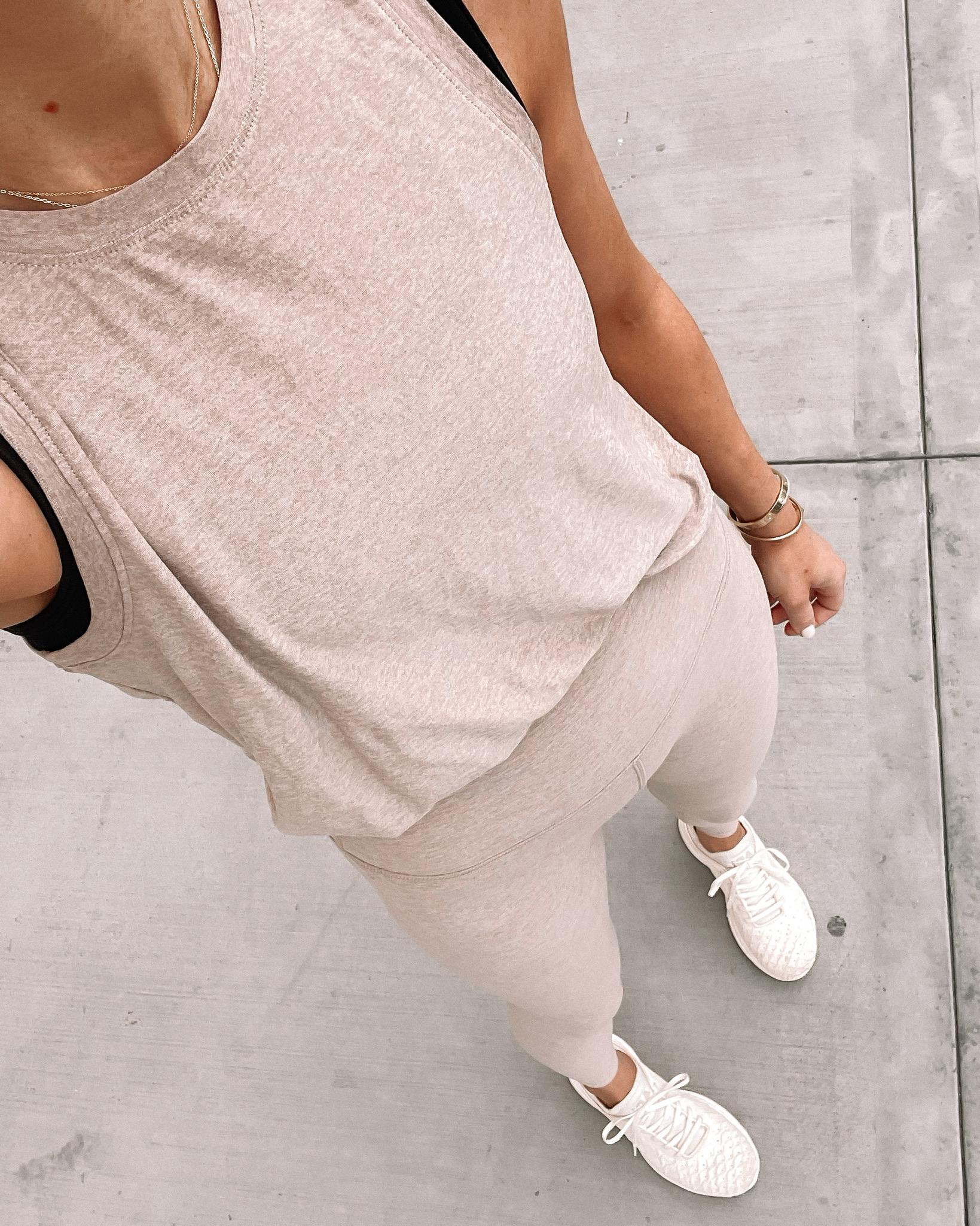 Fashion Jackson Wearing Beyond Yoga Beige Tank Beyond Yoga Beige Leggings APL Sneakers workout outfits for women