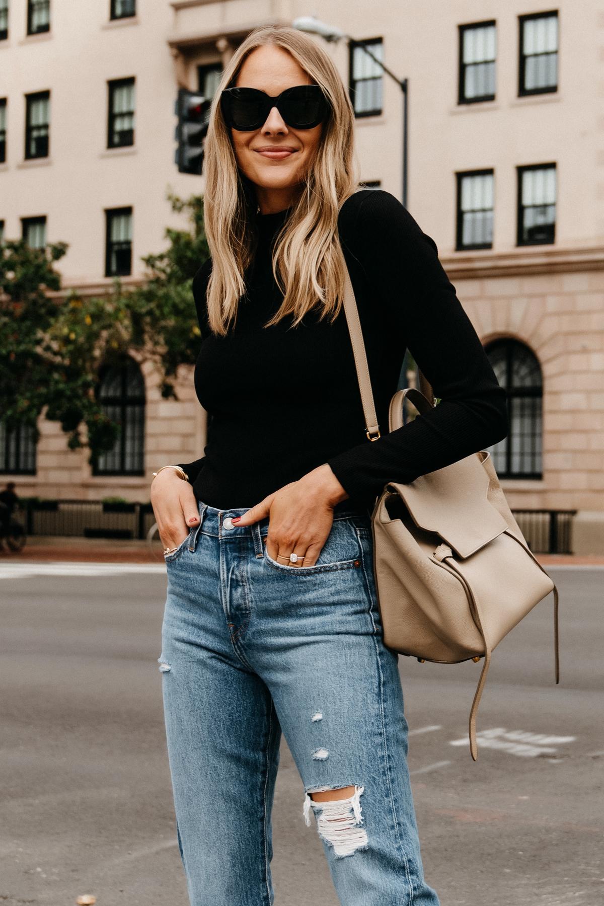 Fashion Jackson Wearing Black Bodysuit Levis Ripped Jeans Celine Belt Bag 1