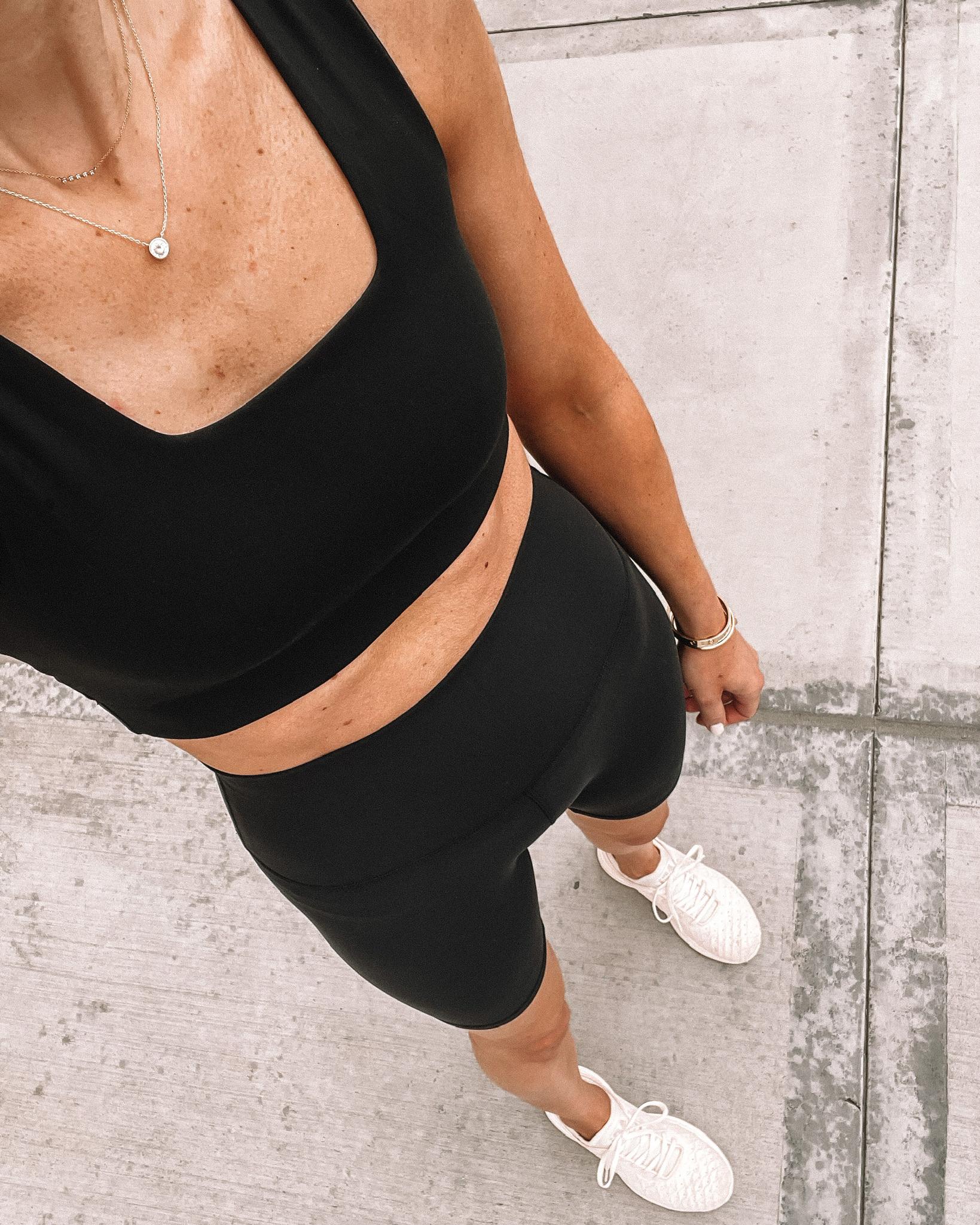 Fashion Jackson Wearing Varley Black Sports Bra lululemon Black Align Biker Shorts APL Sneakers workout outfits for women