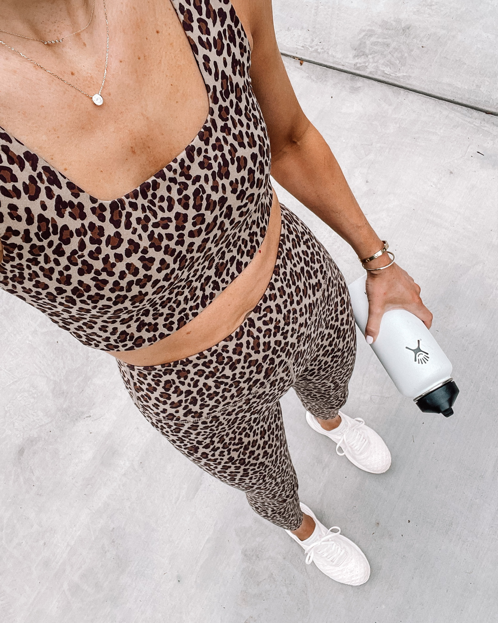 Fashion Jackson Wearing Varley Leopard Sports Bra Varley Leopard Leggings APL Sneakers workout outfits for women