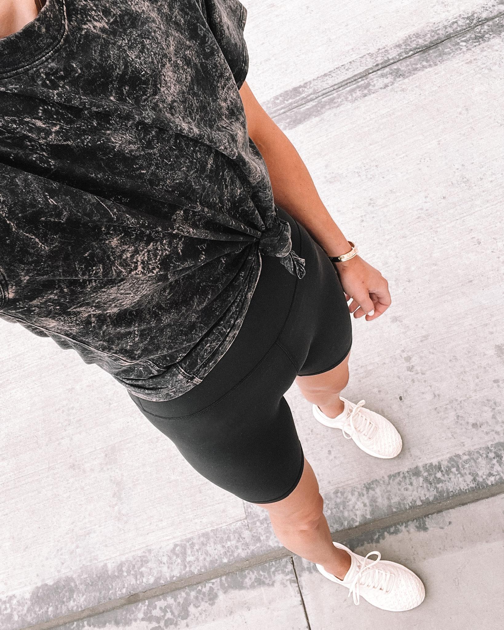 Fashion Jackson Wearing lululemon Black Tie Dye Tshirt lululemon Black Align Biker Shorts APL Sneakers workout outfits for women