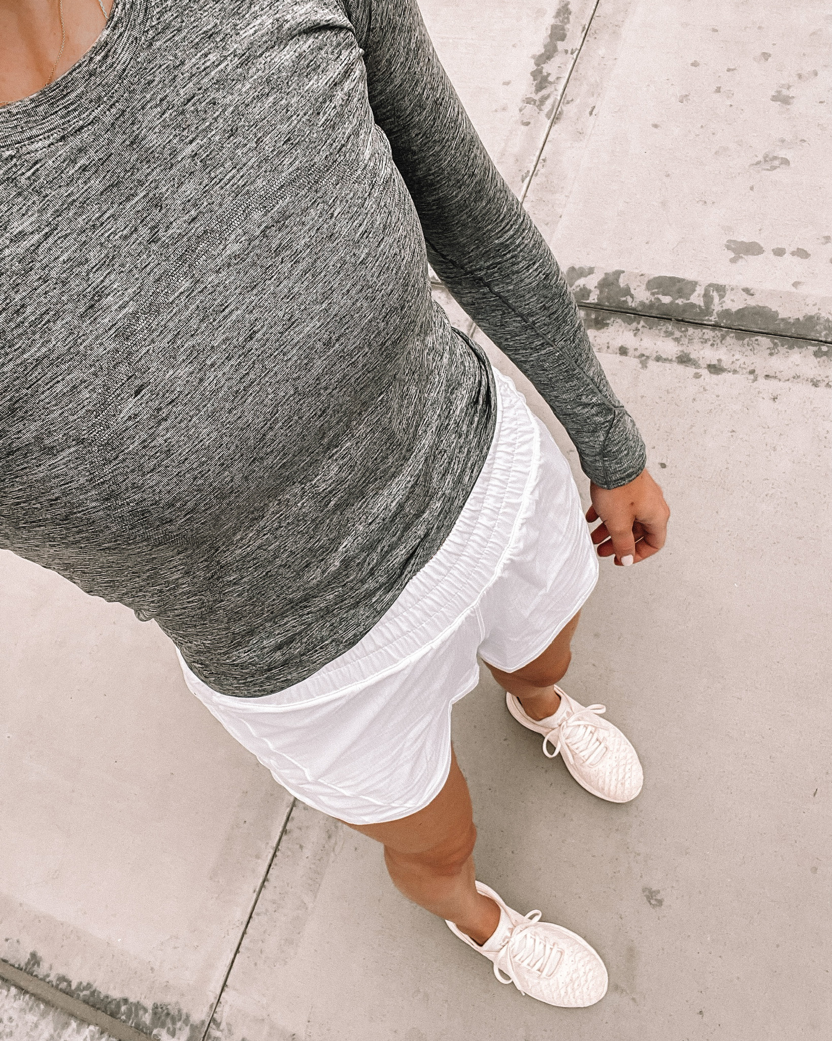 Fashion Jackson Wearing lululemon Swiftly Long Sleeve Top Grey lululelmon White Running Shorts APL Sneakers workout outfits for women