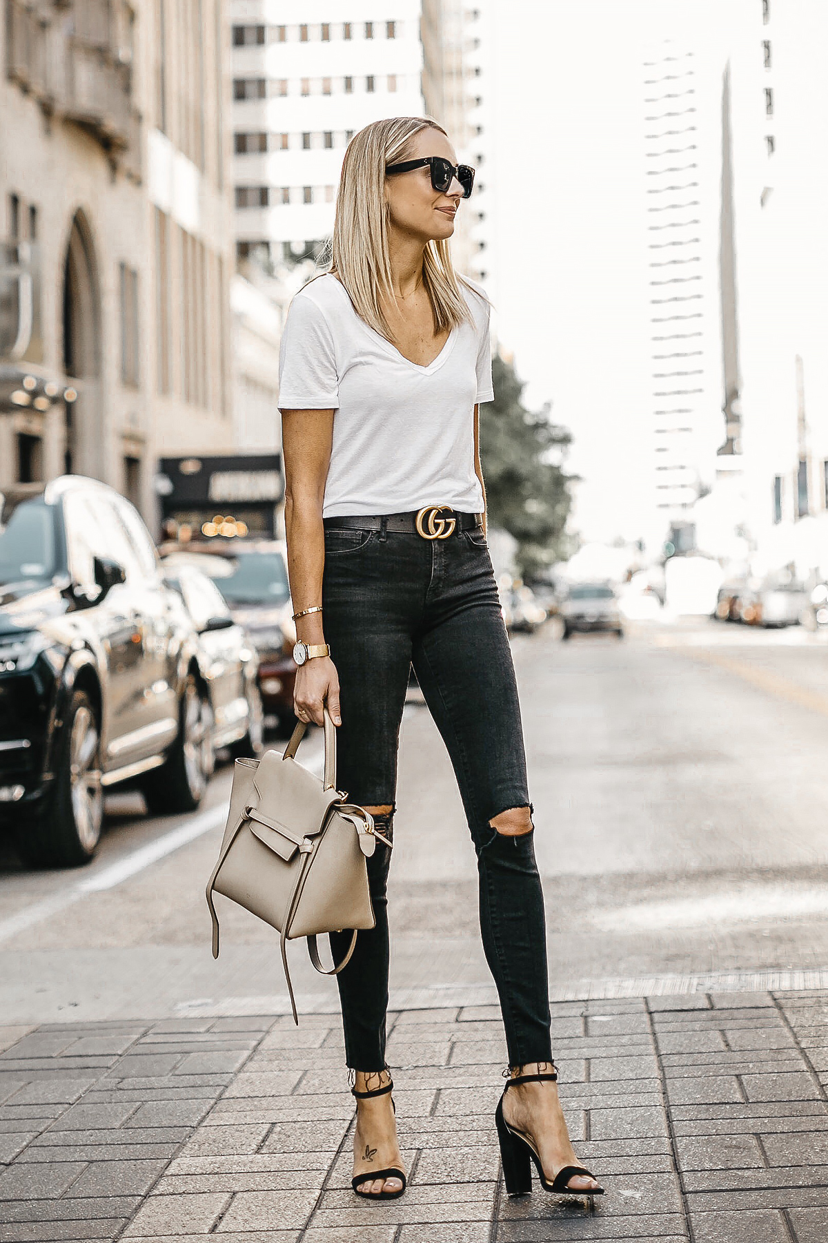 Blonde Woman Waering White Tshirt Black Ripped Skinny Jeans Gucci Marmont Belt Black Ankle Strap Heeled Sandals Celine Mini Belt Bag Fashion Jackson Dallas Blogger Fashion Blogger Street Style
