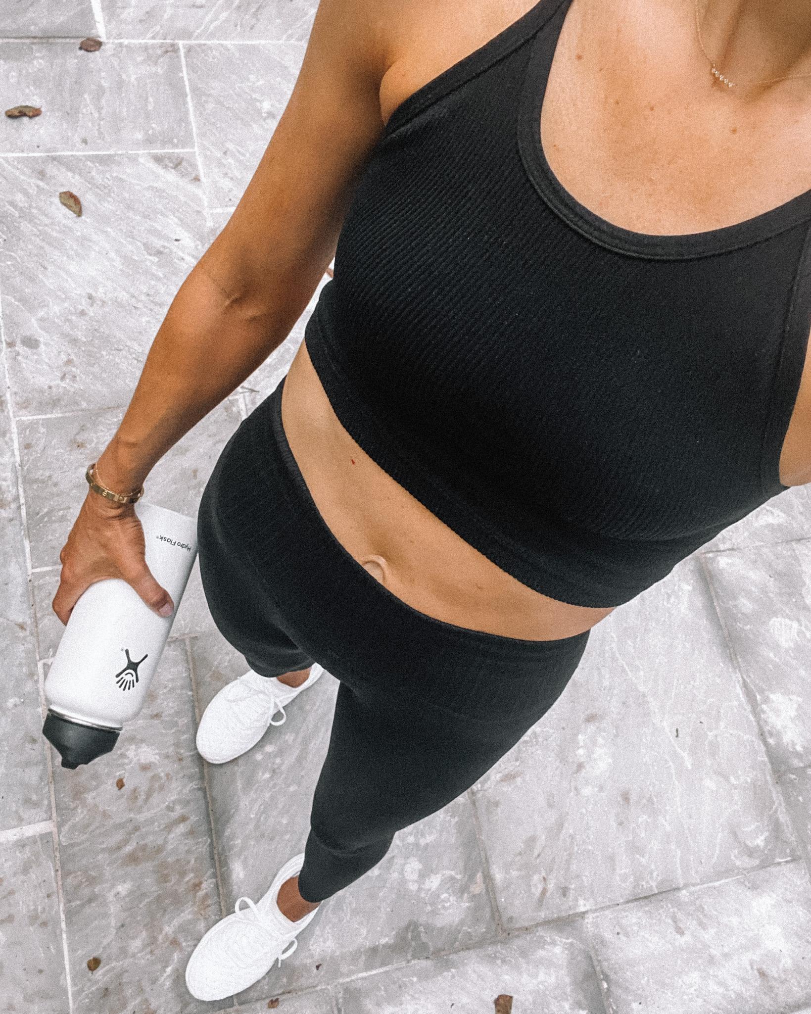 Fashion Jackson Wearing FP Movement Black Good Karma Tank Black Leggings APL Sneakers workout outfits for women