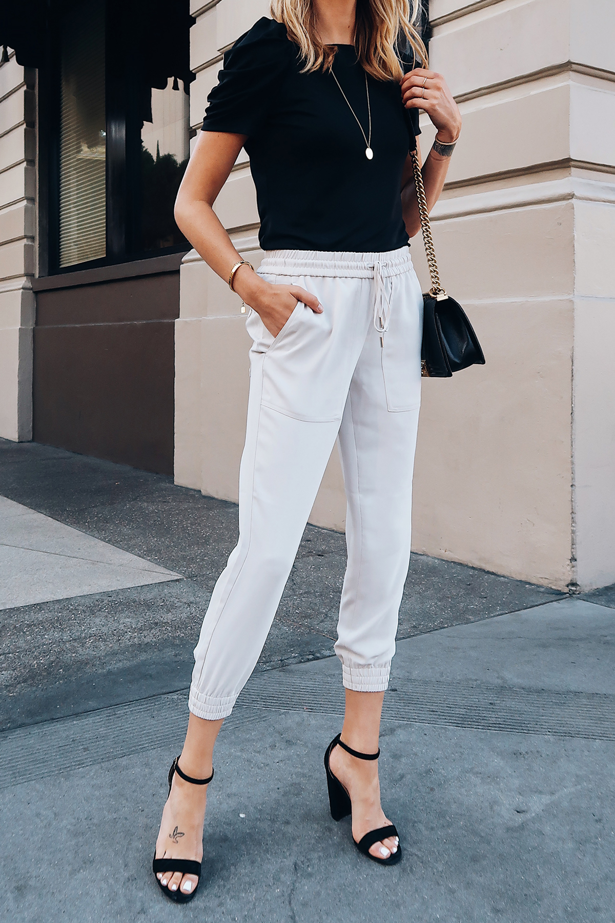 Woman Wearing Ann Taylor Black Ruched Sleeve Top Ivory Jogger Pants Black Ankle Strap Heeled Sandals Fashion Jackson San Diego Blogger Fashion Blogger Street Style